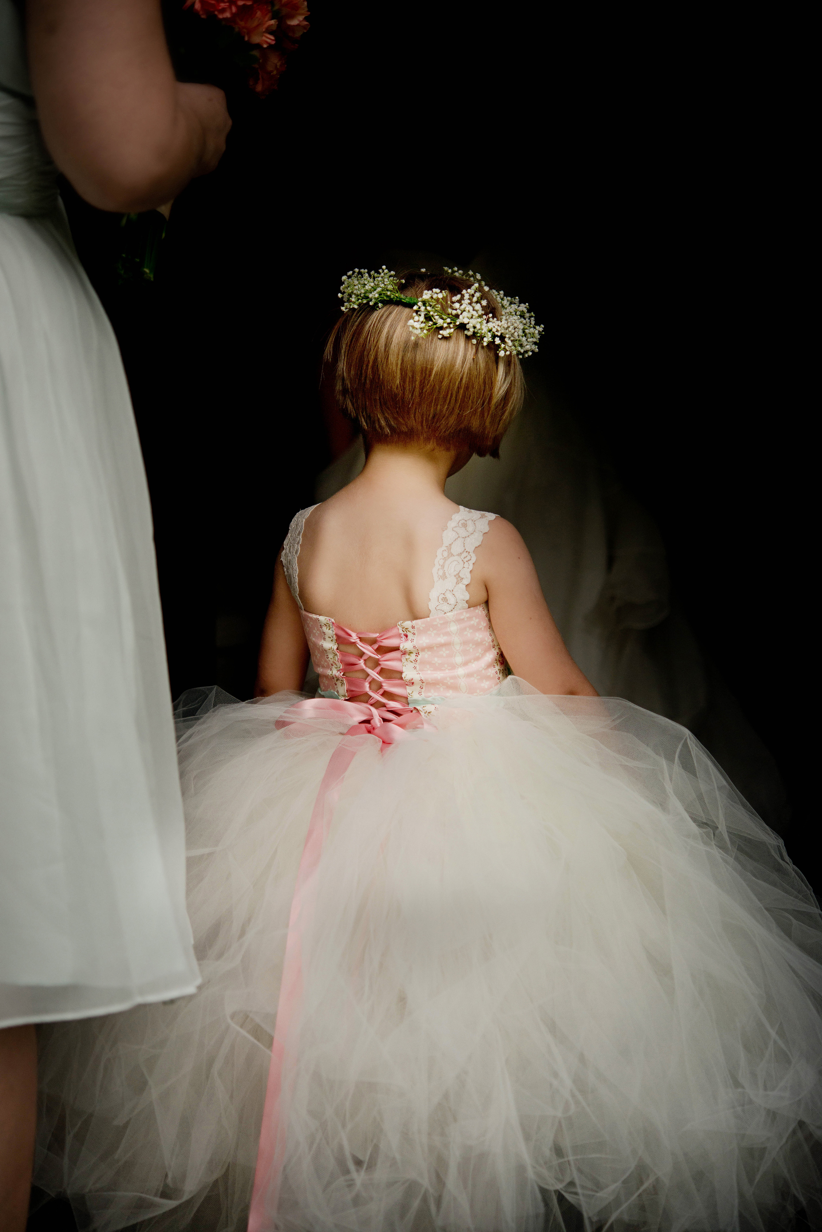 Little girl in pink tulle lace up dress and flower crown - photo by Gloria Ruth Photography