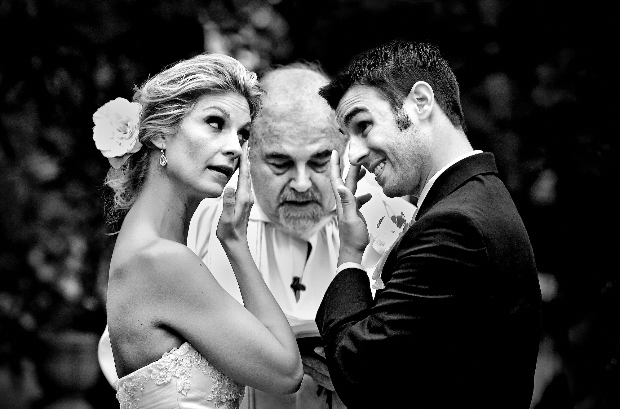 At ceremony with cleric bride and groom both wipe a tear - photo by Matthew Sowa Photography