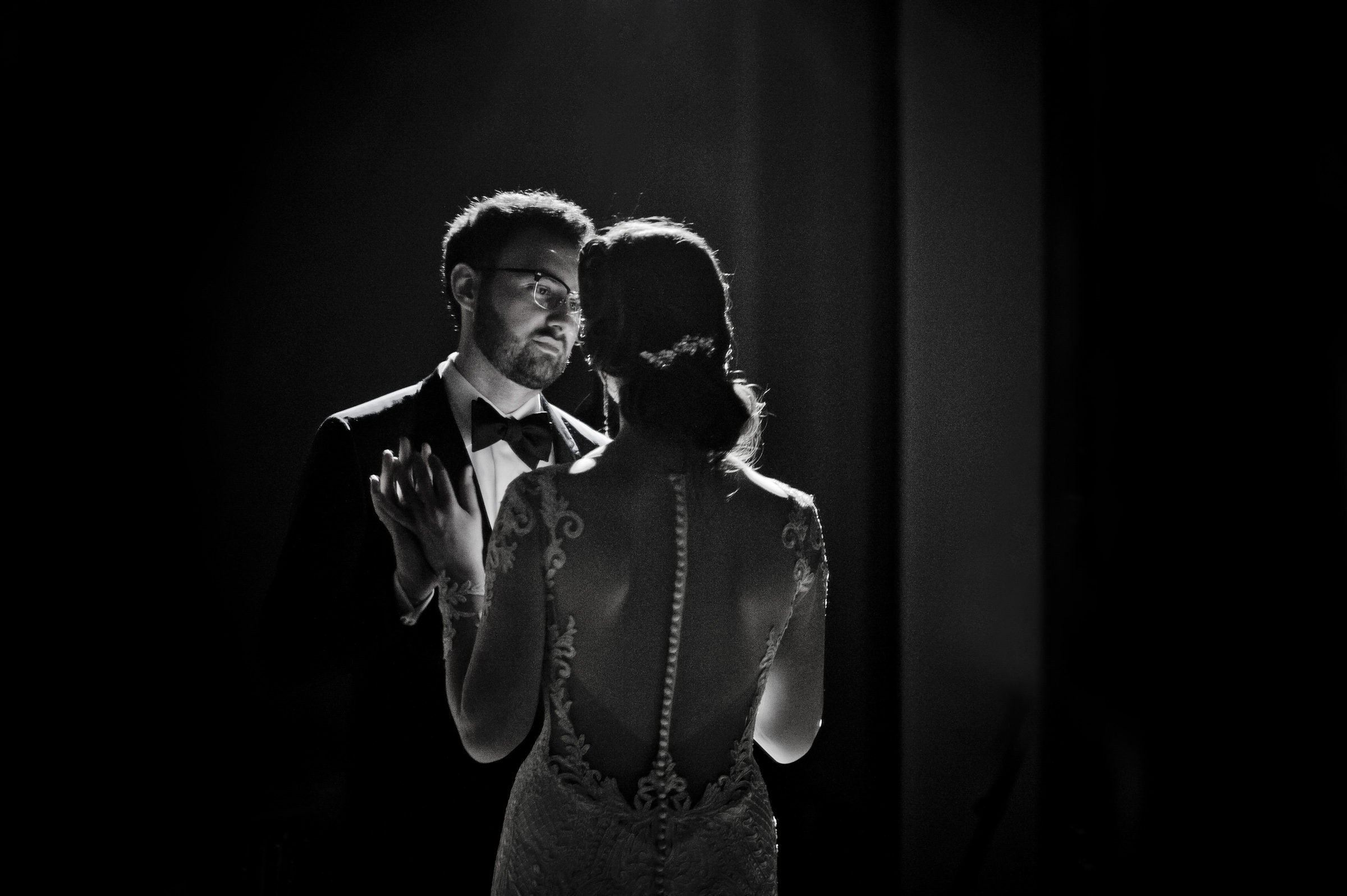 Backlit bride and groom facing - photo by Matthew Sowa Photography