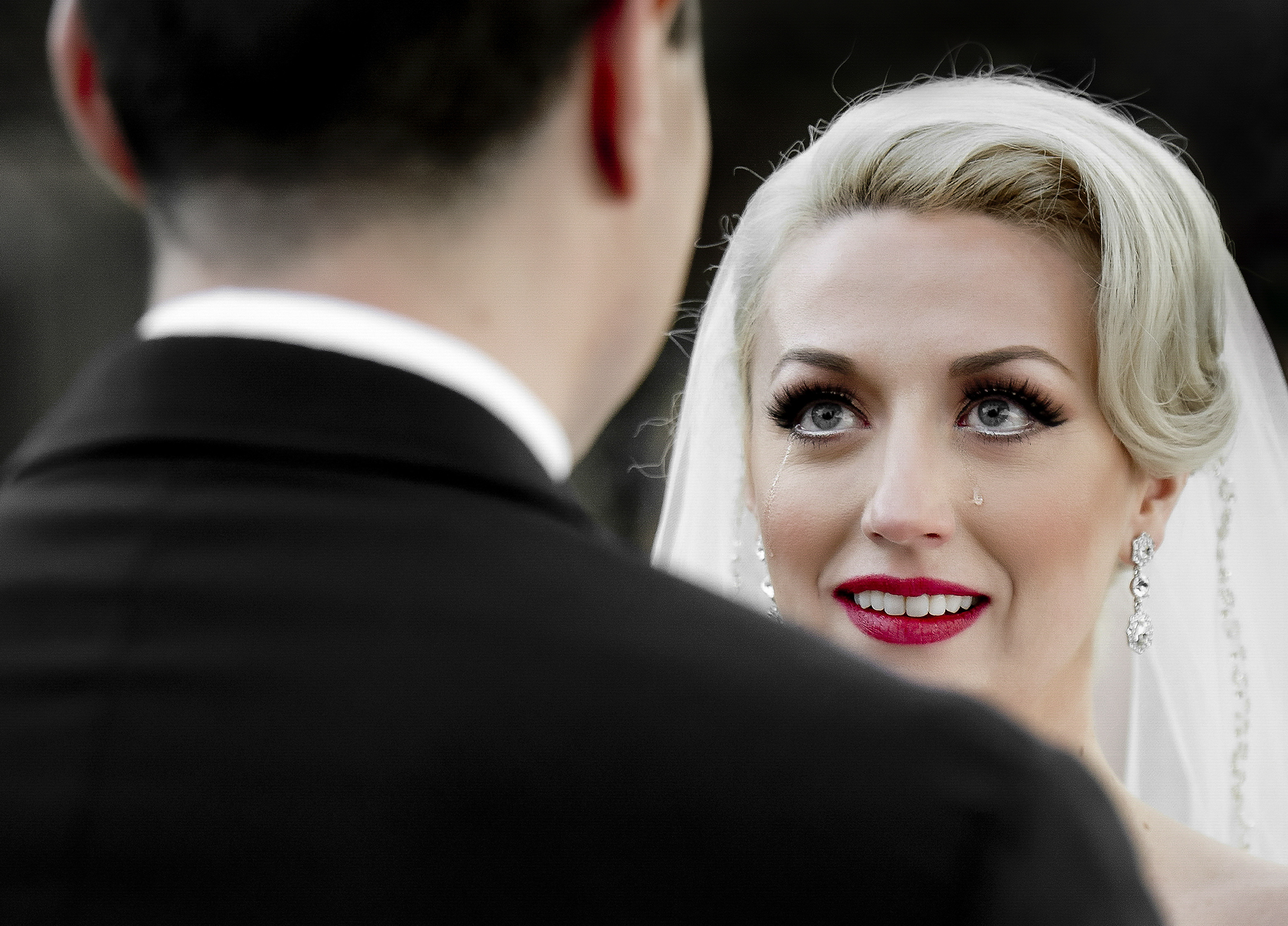 Bride gazes adoringly at her groom - photo by Matthew Sowa Photography