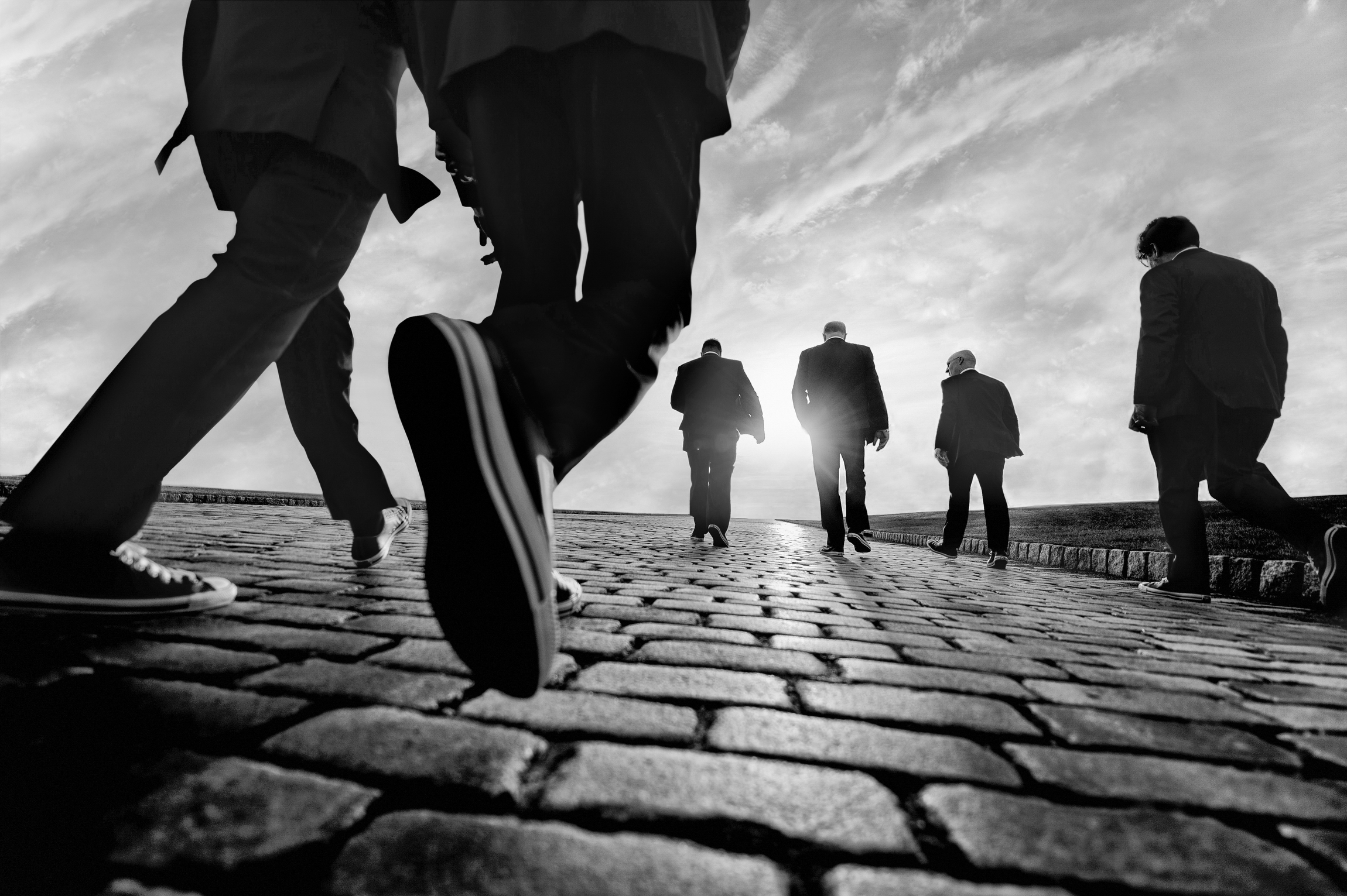Creative composition of walkers on cobblestones - photo by Matthew Sowa Photography