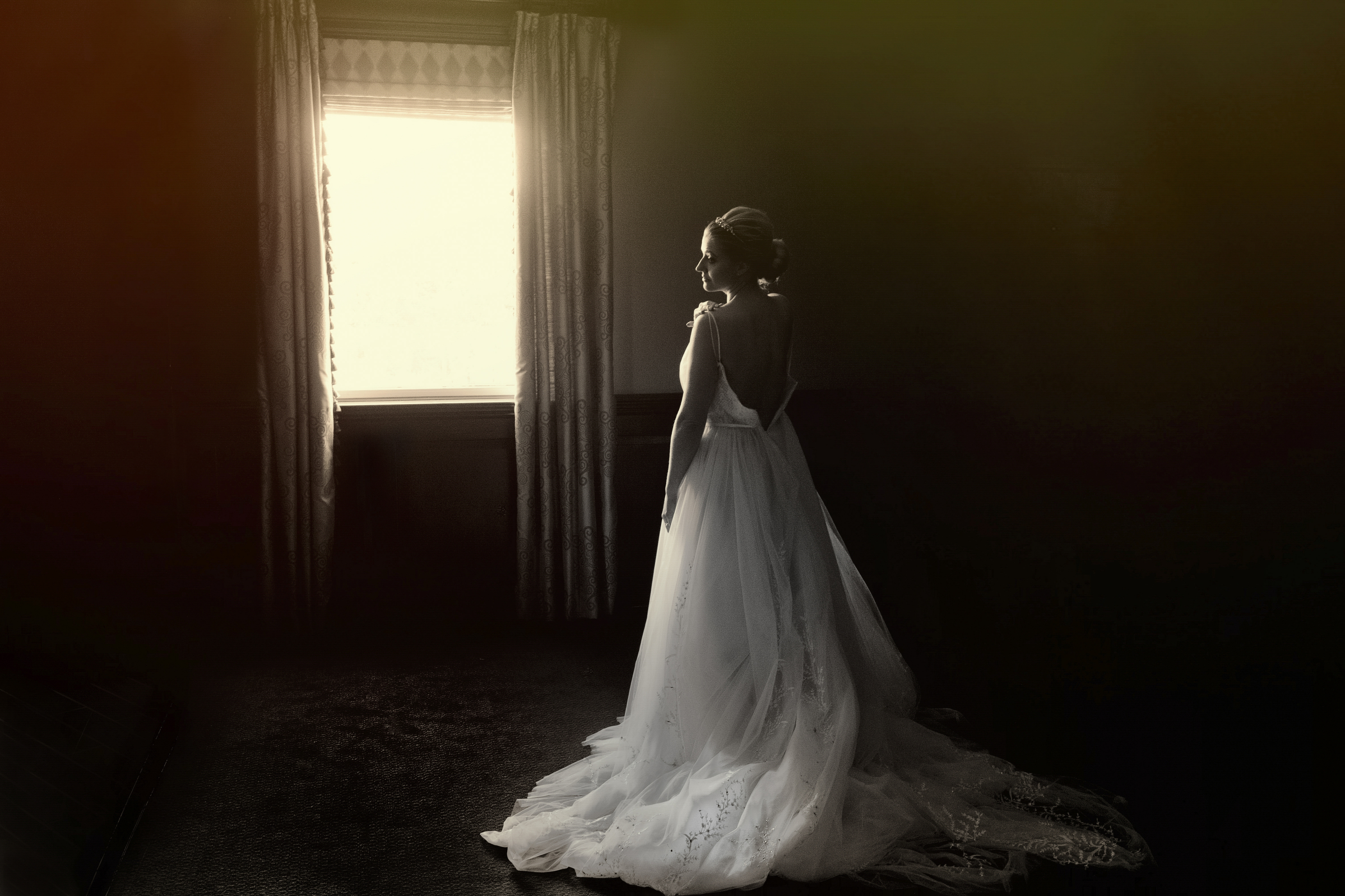 Full length back view of bride in window light - photo by Matthew Sowa Photography