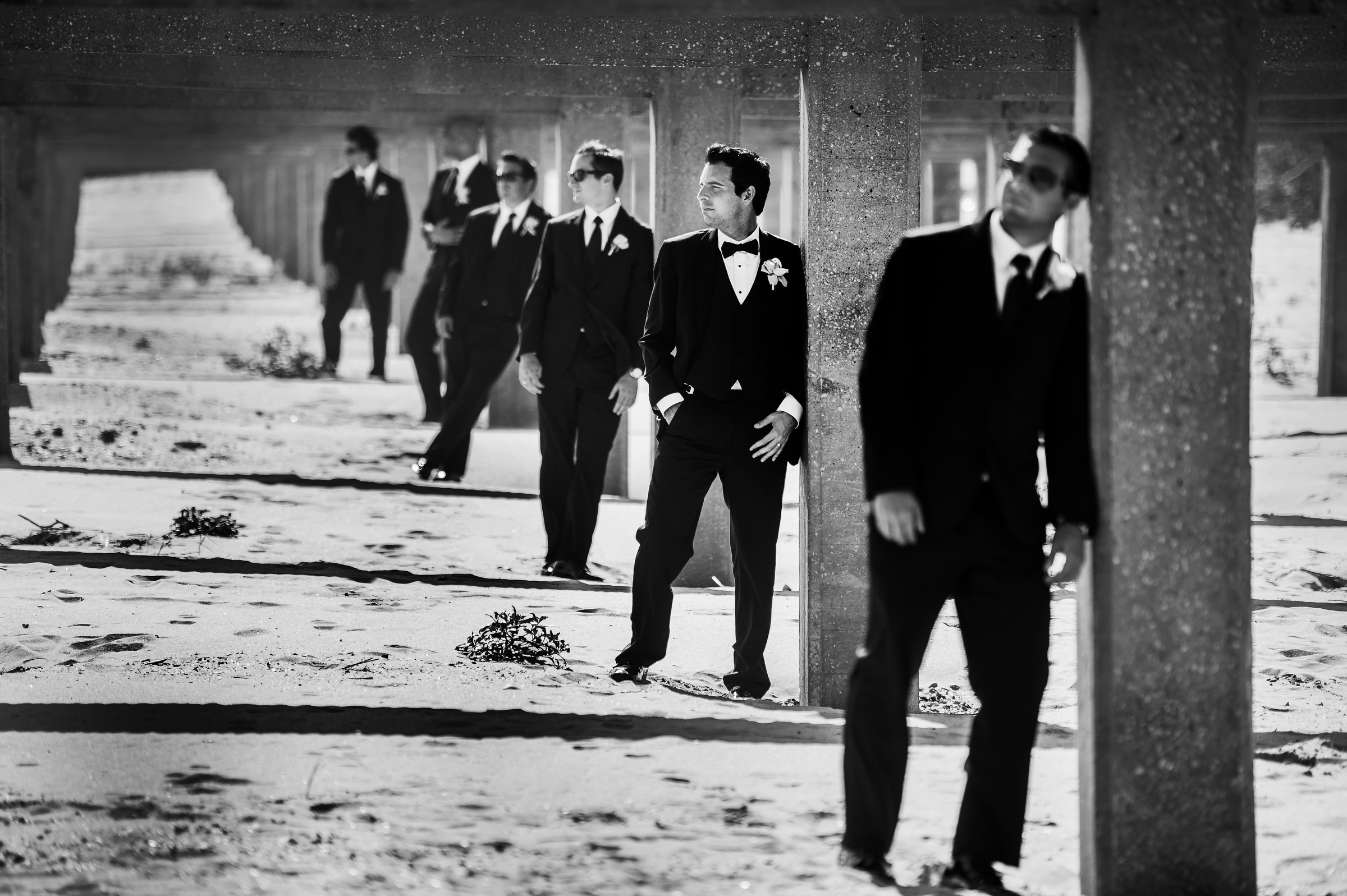 Groomsmen against columns in the snow - photo by Matthew Sowa Photography