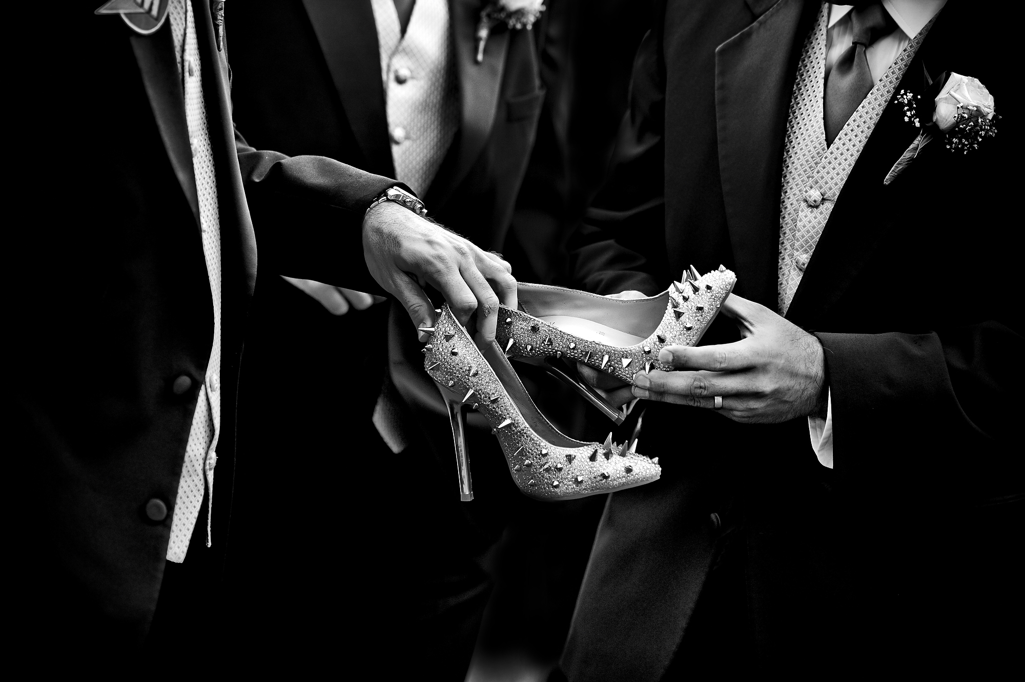 Men handling spiky high heel shoes - photo by Matthew Sowa Photography