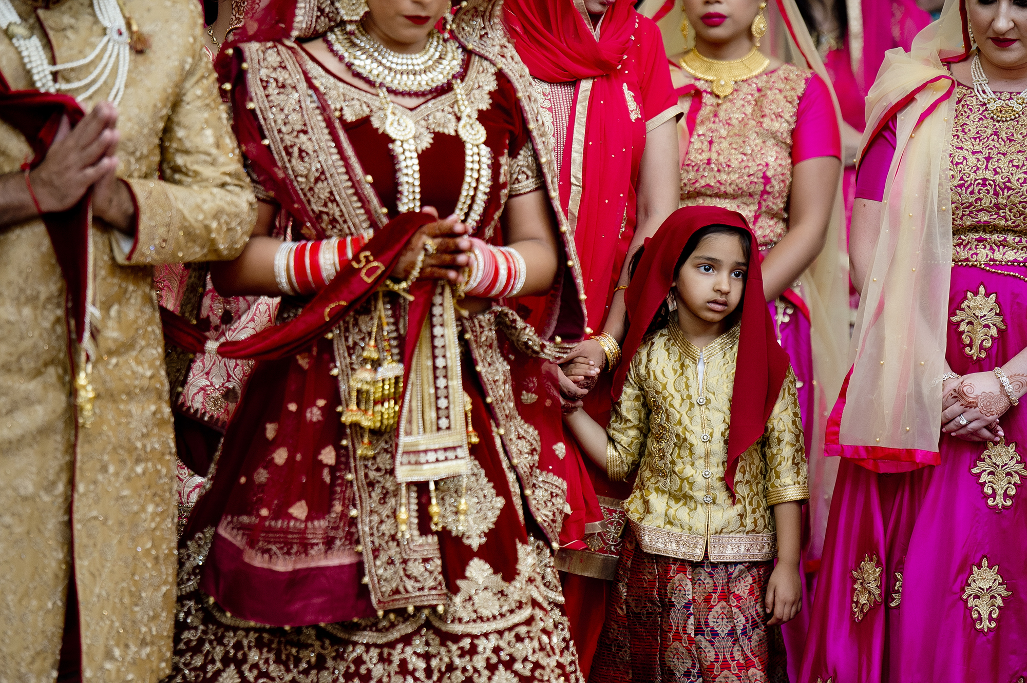Serious child amidst women at Indian wedding - photo by Matthew Sowa Photography
