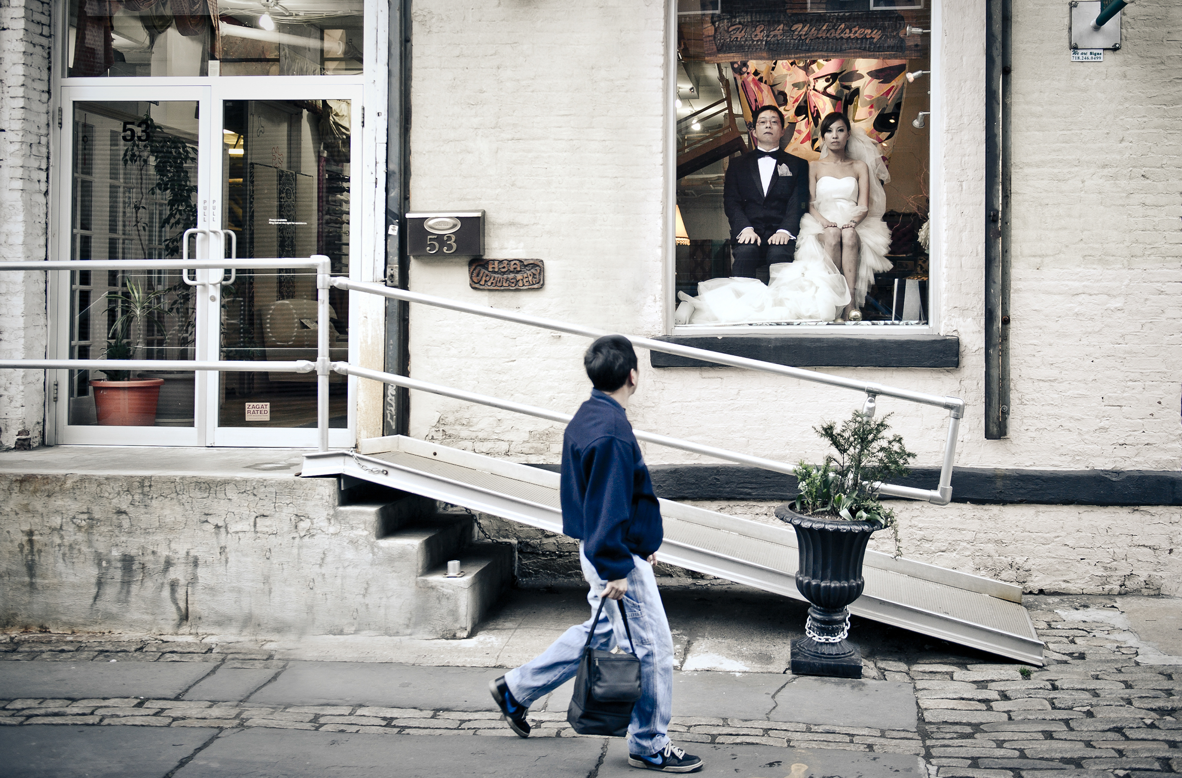 Couple reflected in shop window with passerby - photo by Matthew Sowa Photography
