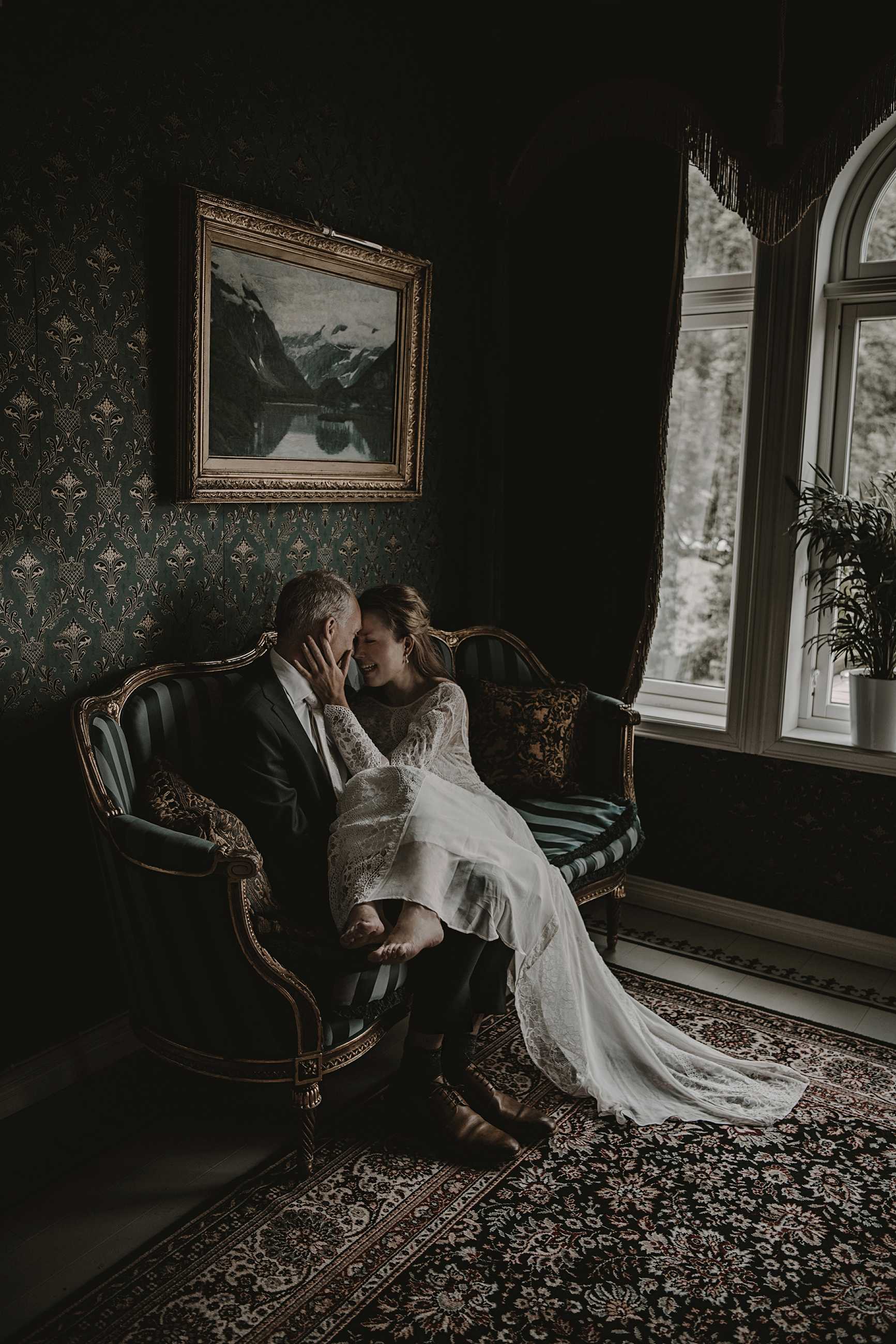 Couple on loveseat - photo by Frøydis