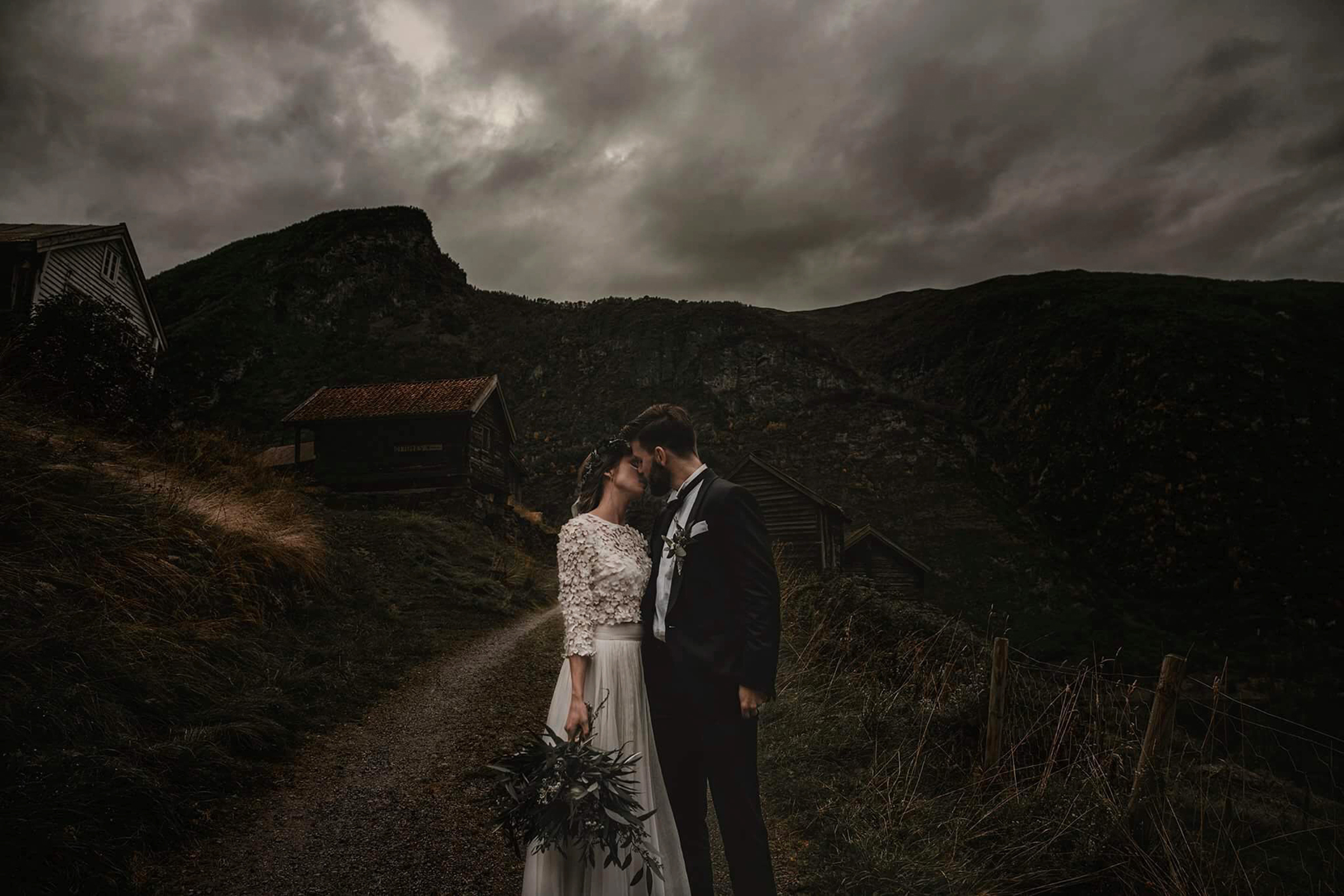 Kiss in stormy rustic mountain setting - photo by Frøydis