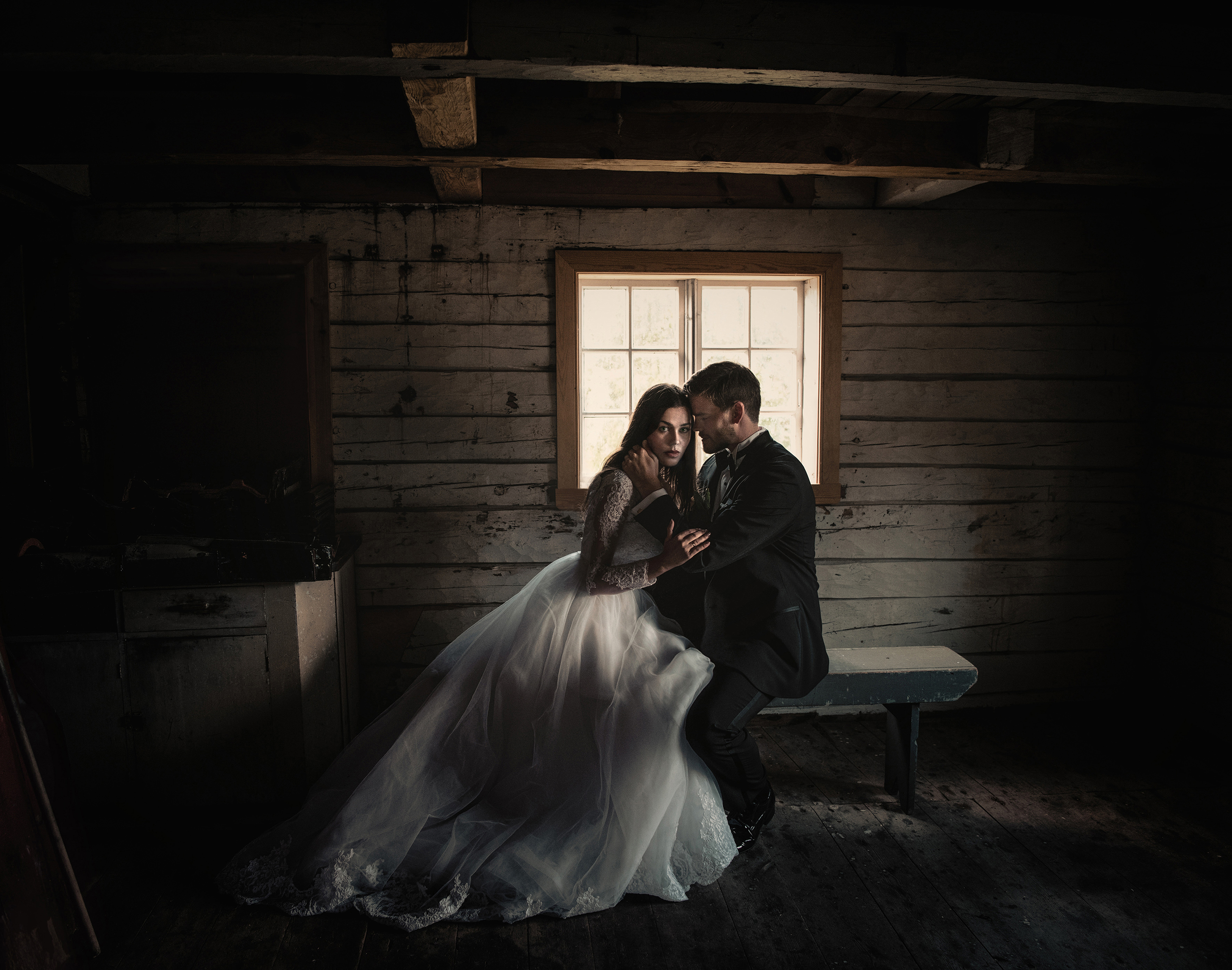 Romantic couple portrait in rustic cabin - photo by Frøydis