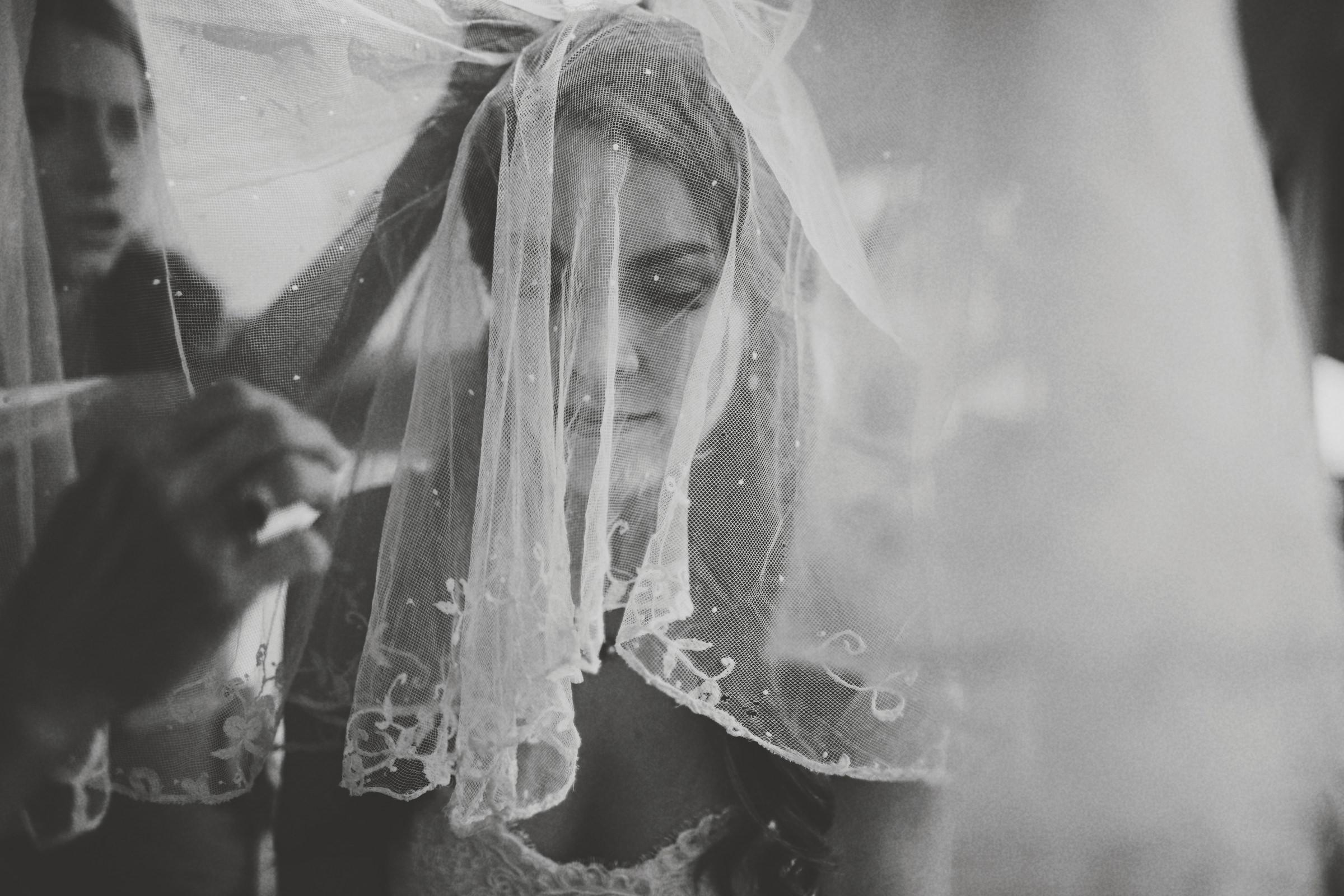 Bride portrait through veil - photo by Jonas Seaman Photography