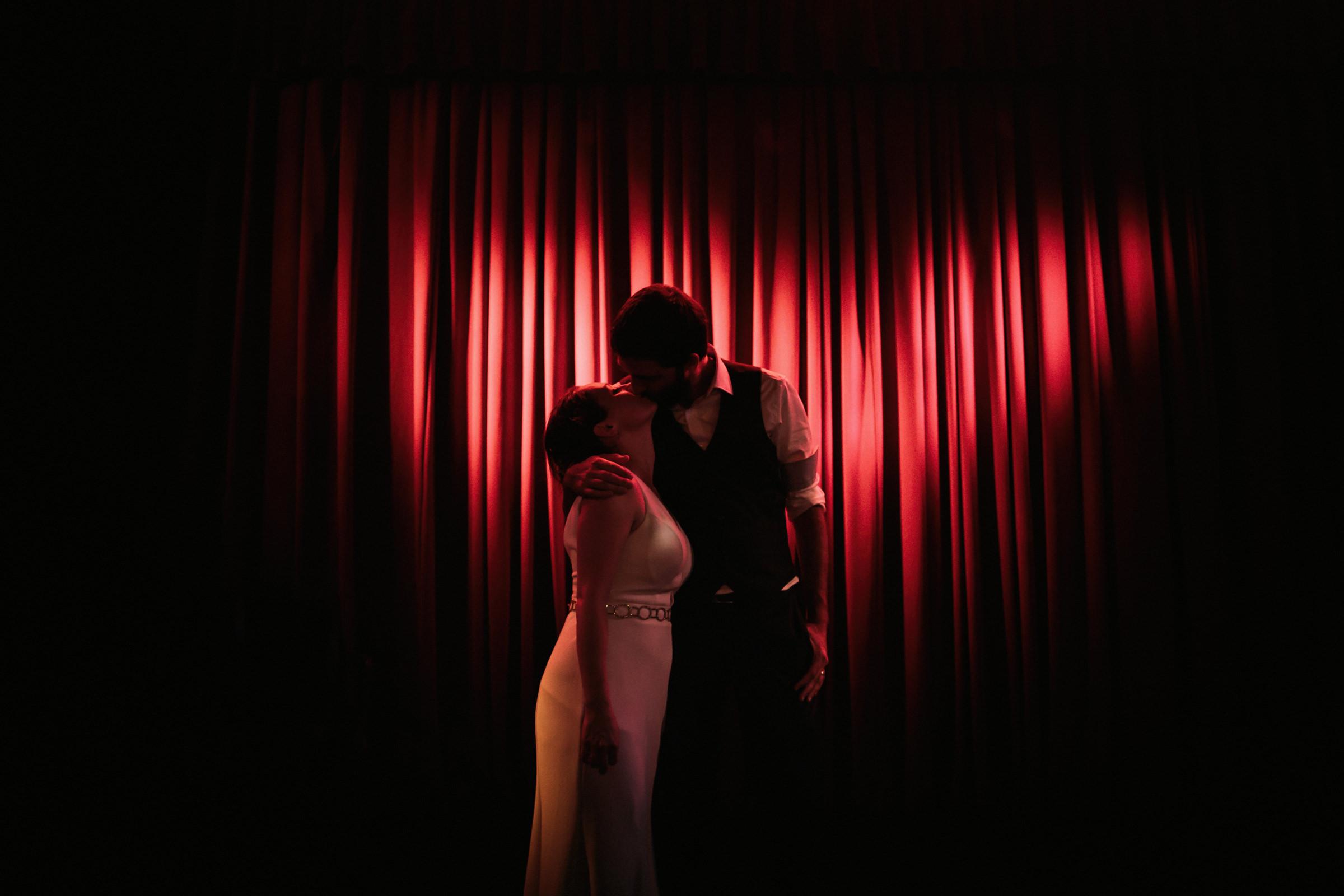 Couple kiss in heart shaped spotlight- photo by Jonas Seaman Photography