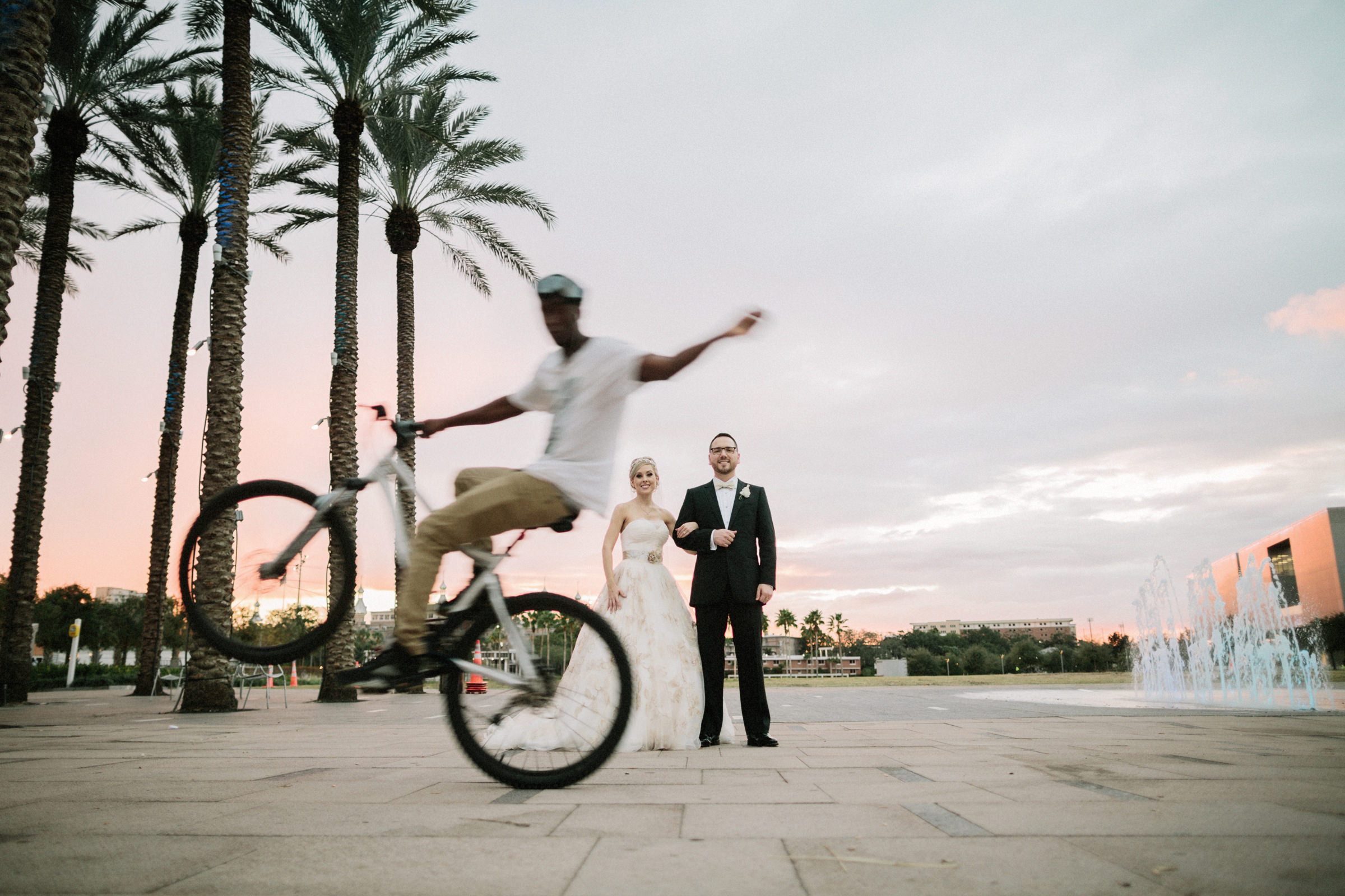 Couple portrait in tropics with trick bicyclist - photo by Jonas Seaman Photography