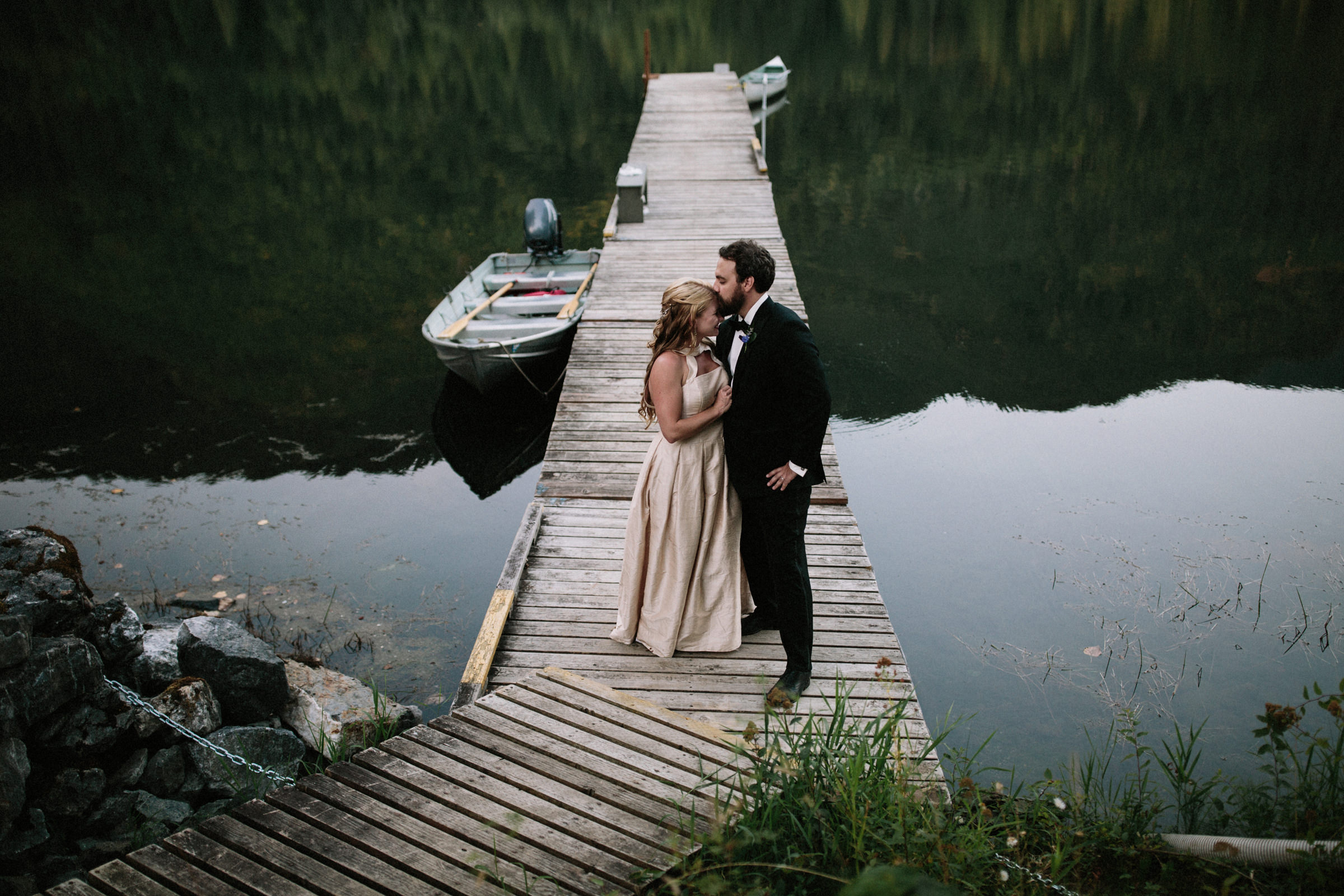 Couple portrait on dock - photo by Jonas Seaman Photography