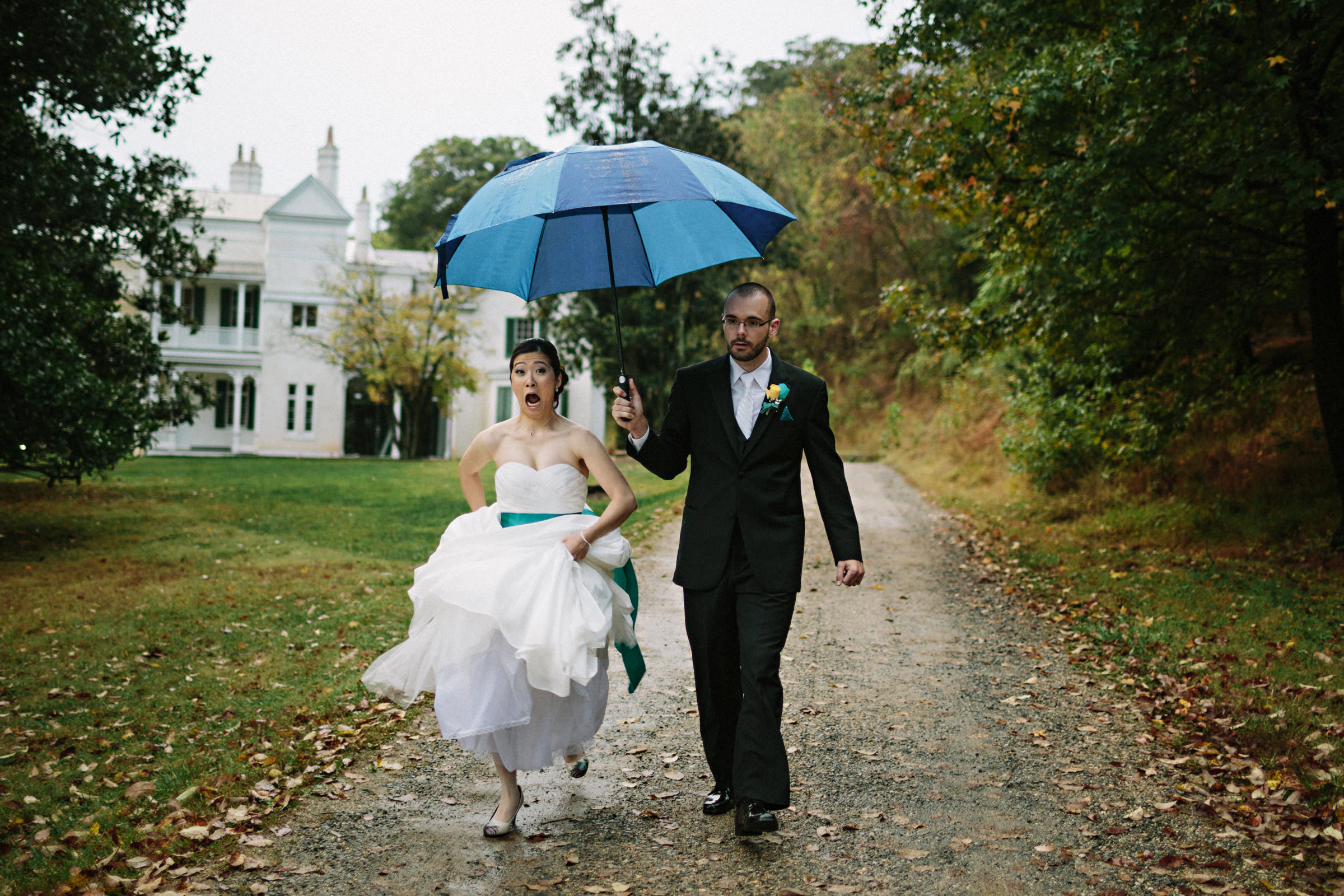Couple with umbrella on rustic road - photo by Jonas Seaman Photography