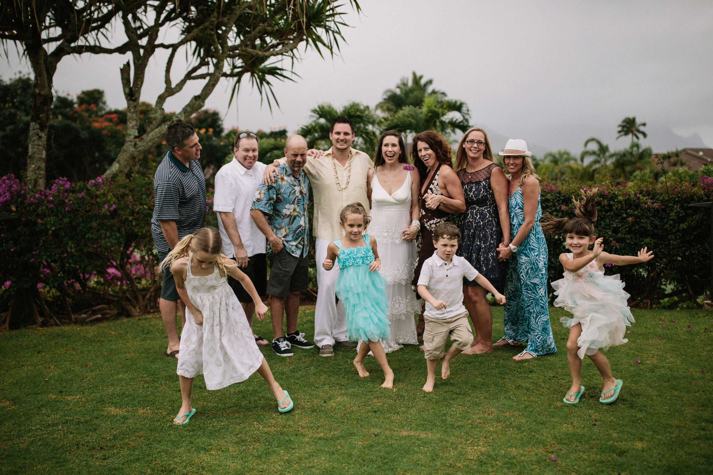 Group shot of family with kids in tropical setting - photo by Jonas Seaman Photography