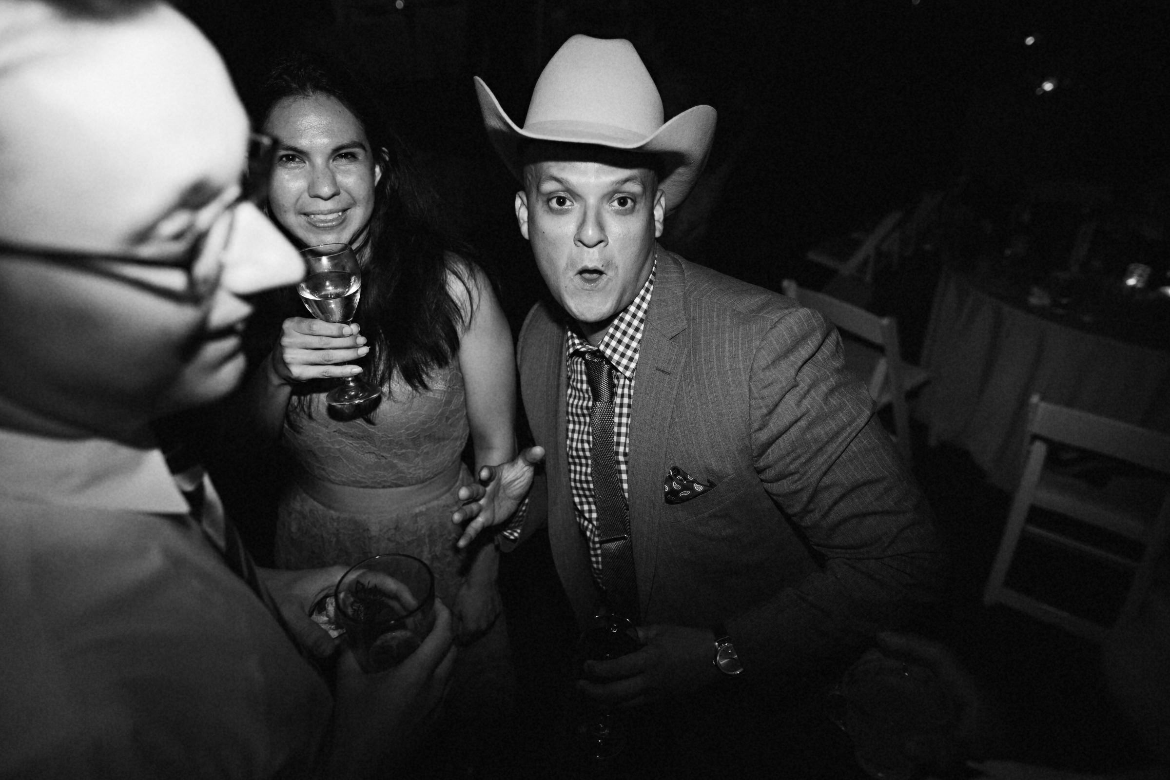 Party guest with cowboy hat - photo by Jonas Seaman Photography
