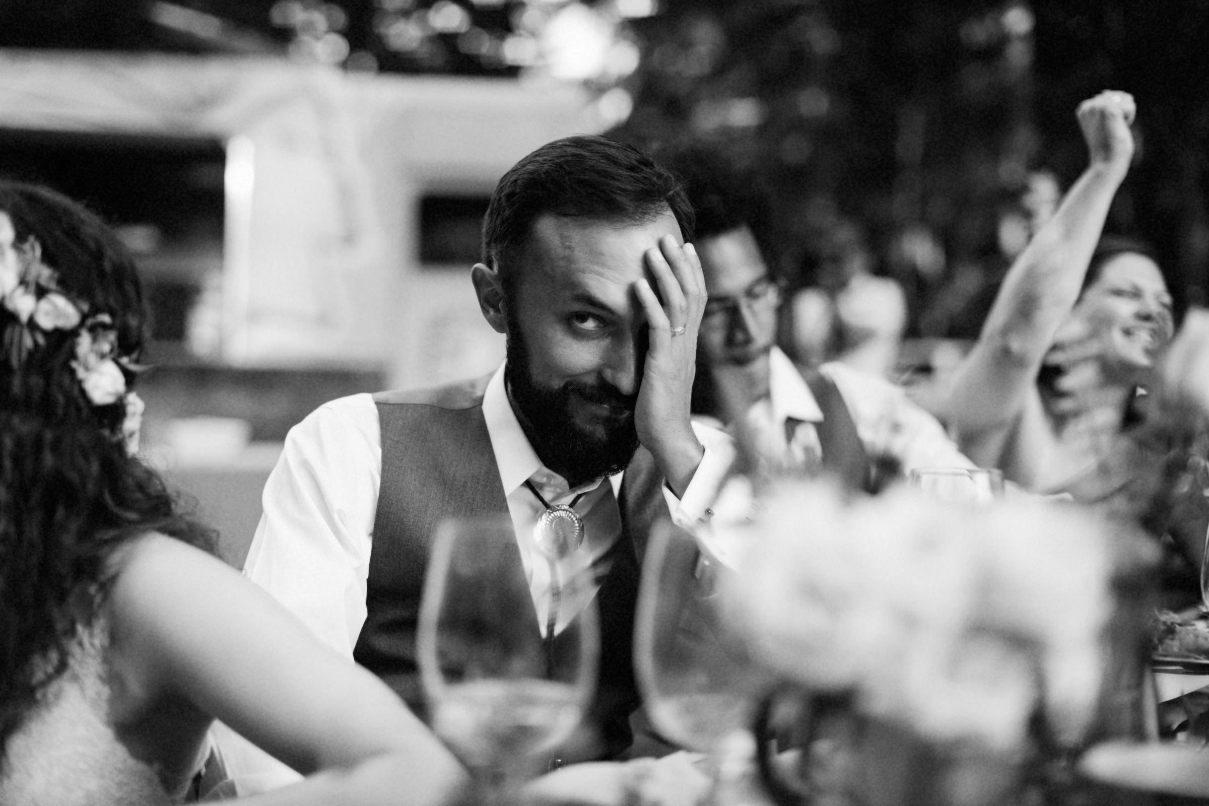 Side eye from the groom - photo by Jonas Seaman Photography