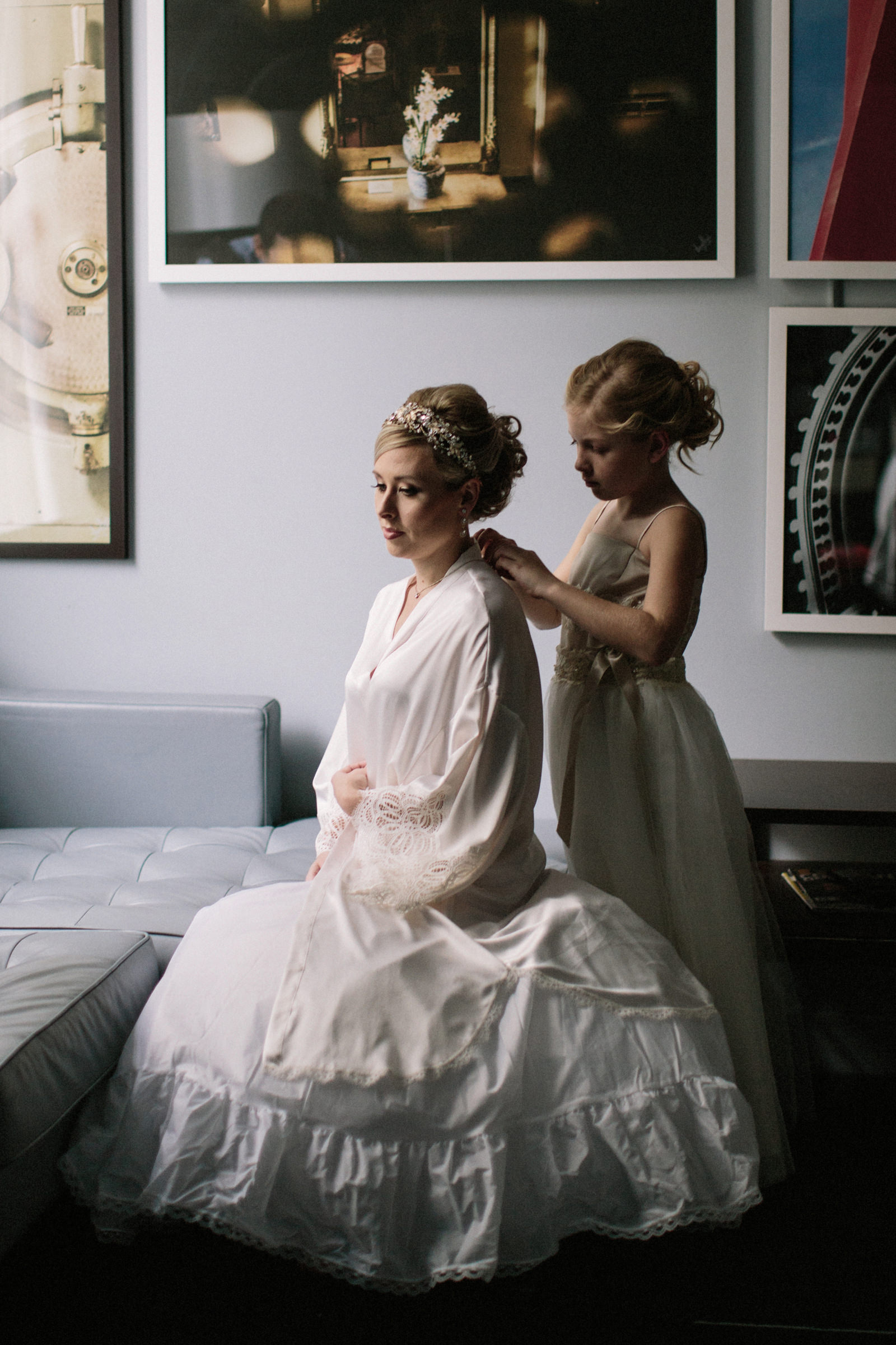 Young girl helping bride get ready - photo by Jonas Seaman Photography