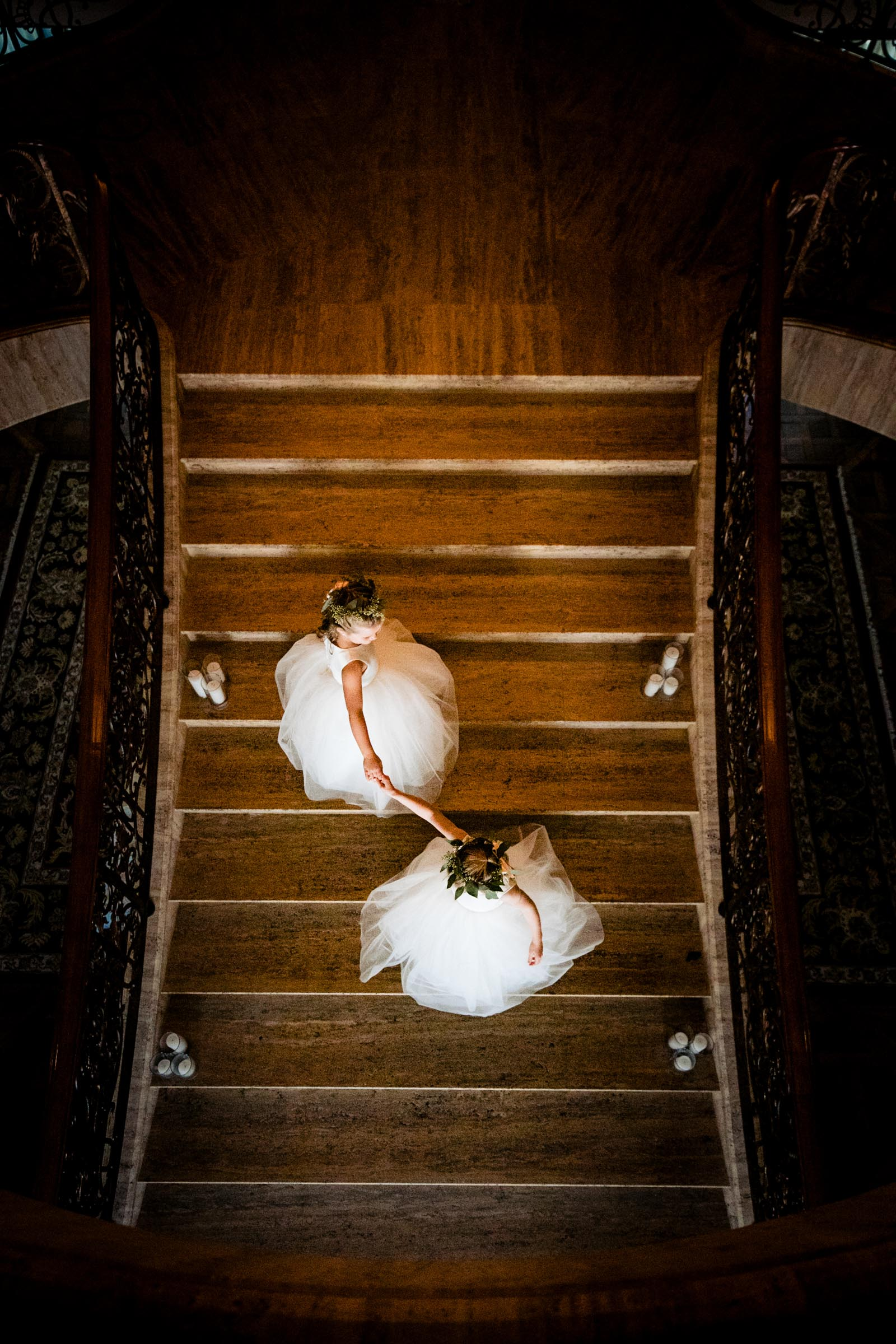 Aerial view of flower girls on staircase - photo by Marissa Joy Photography