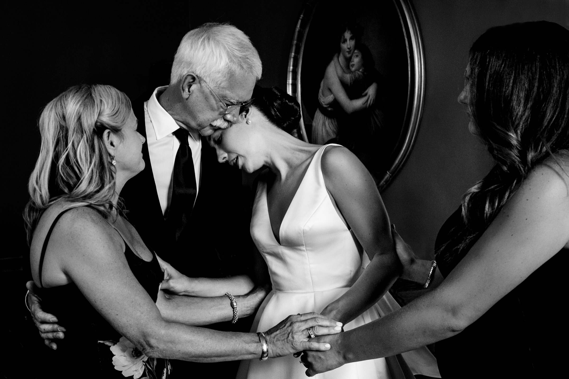 Bride with parents  - photo by Marissa Joy Photography