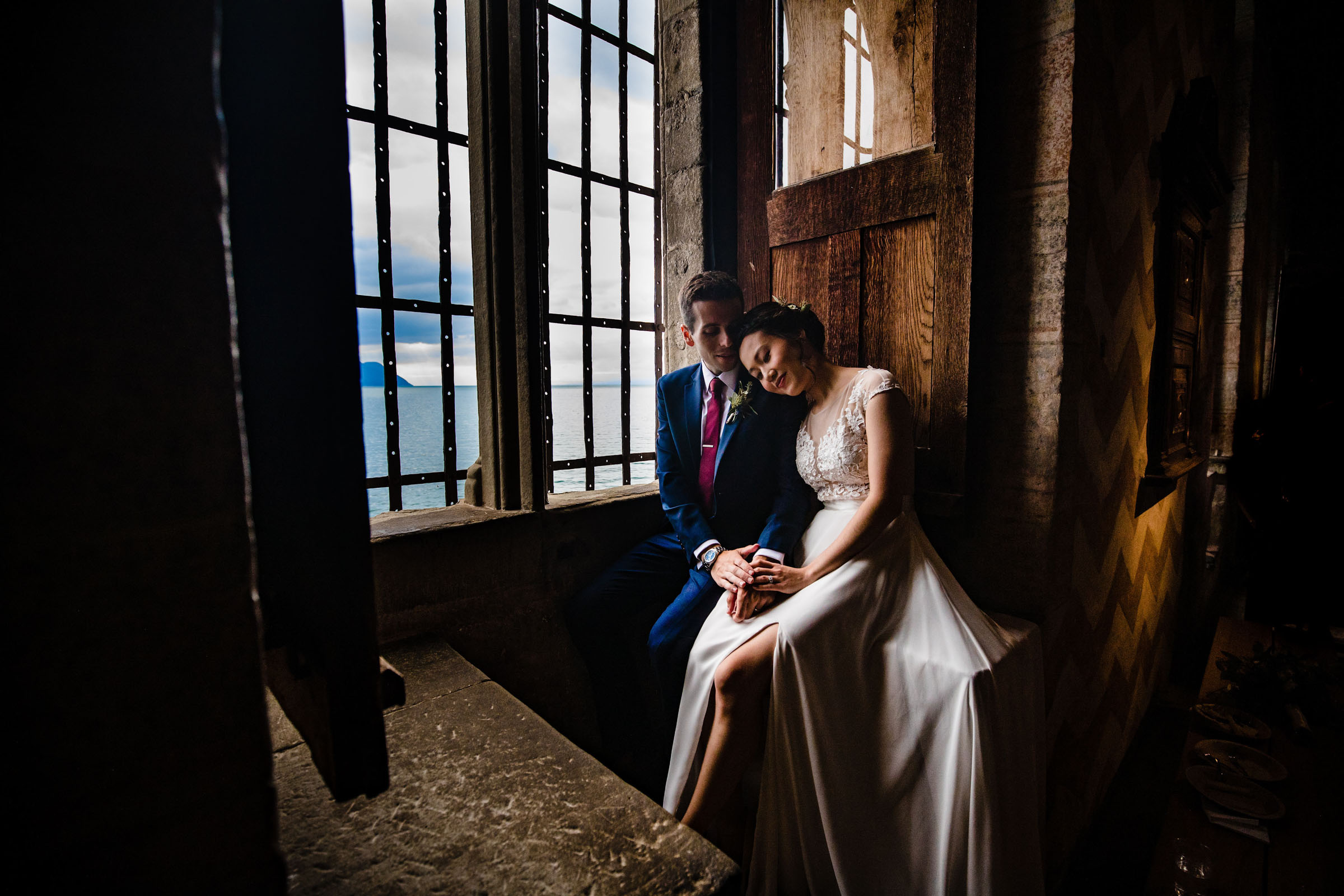 Couple by window in rustic indoor setting - photo by Marissa Joy Photography