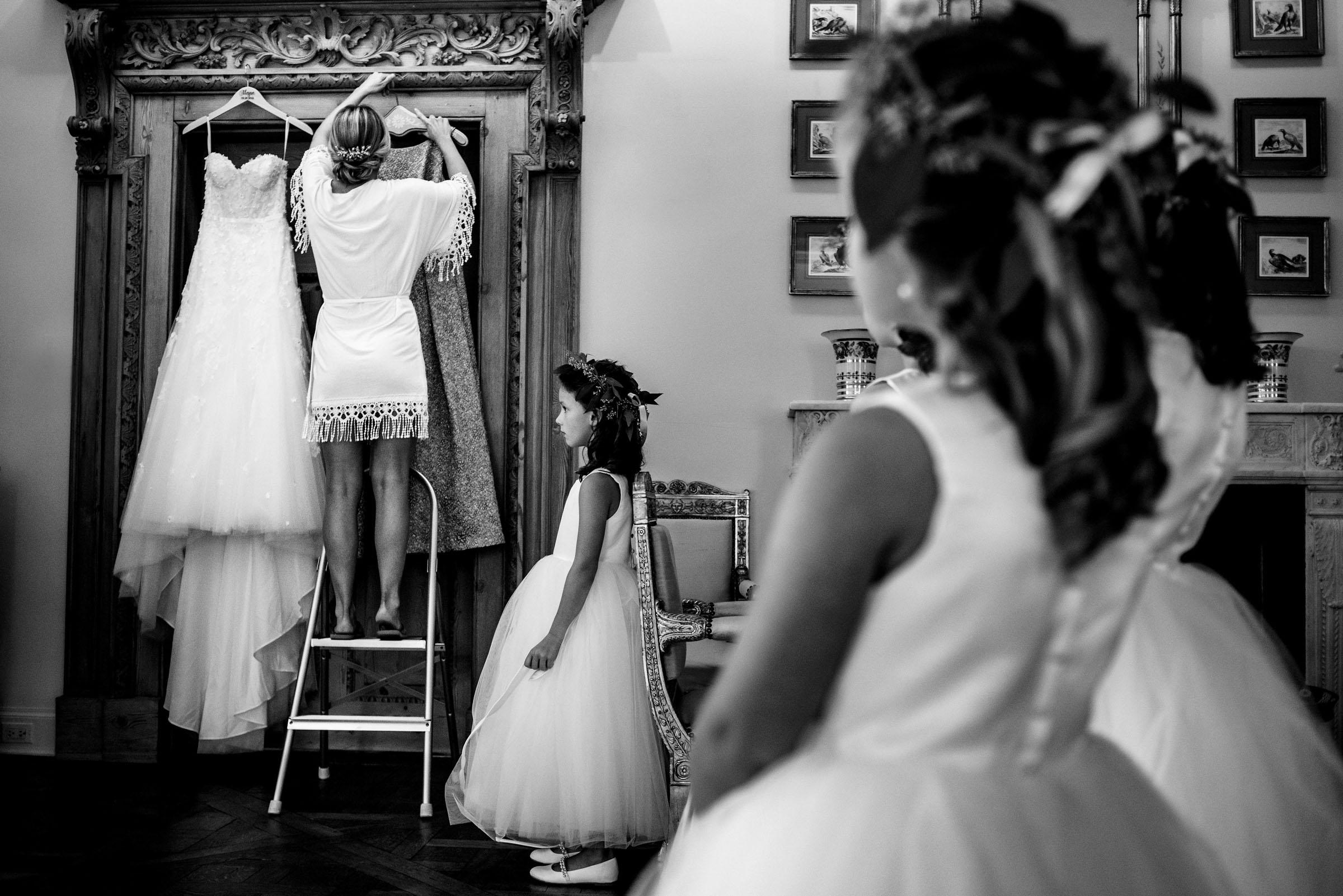 Flower girls watch bride getting dressed - photo by Marissa Joy Photography