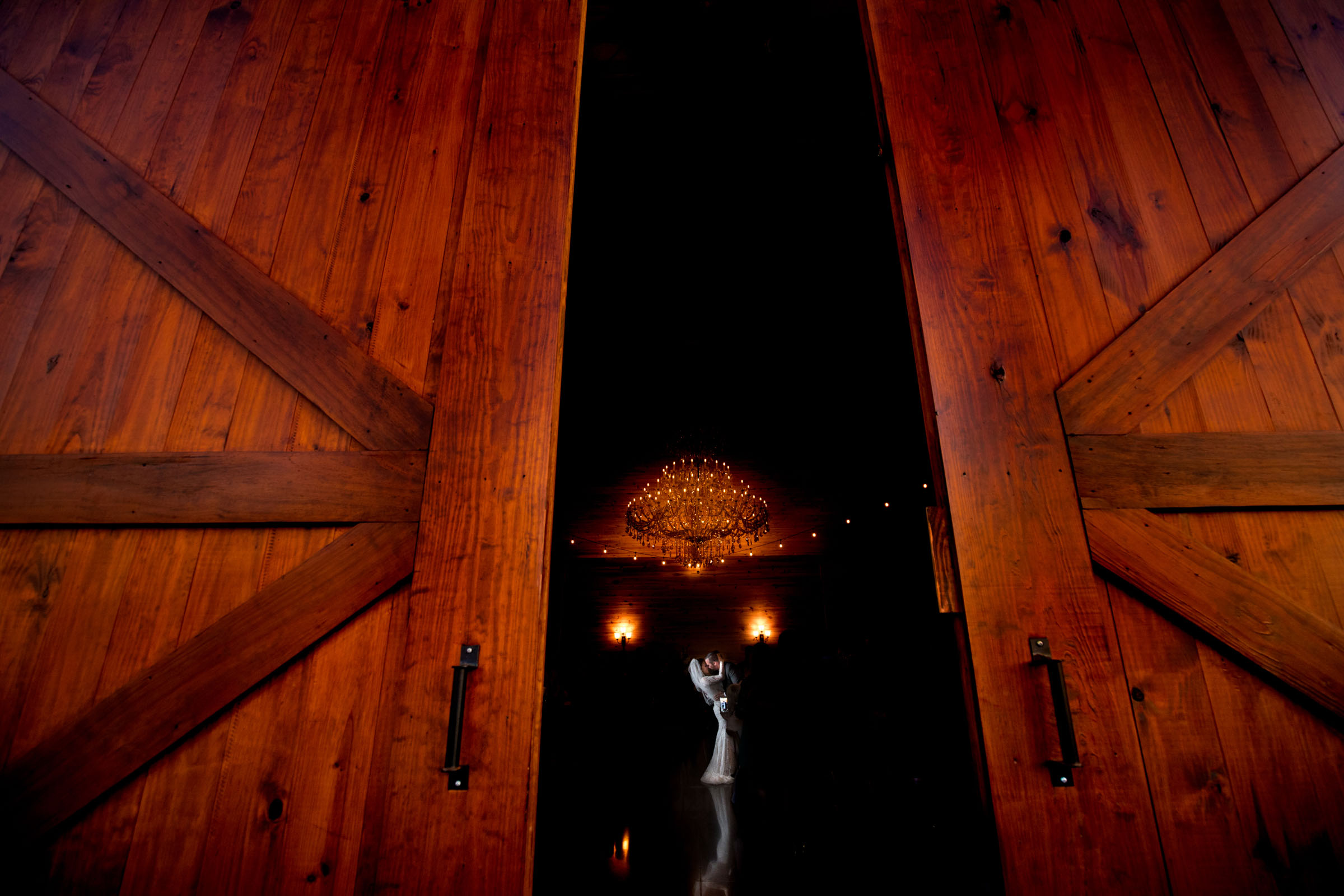 Kissing silhouette through wooden doors - photo by Marissa Joy Photography