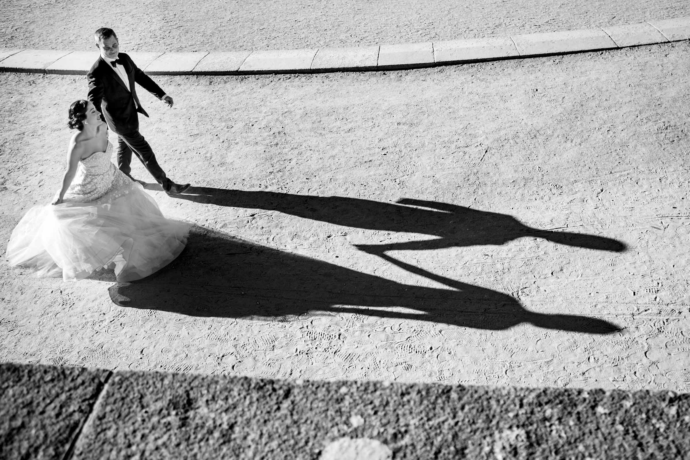Couple and their shadows holding hands - photo by Marissa Joy Photography