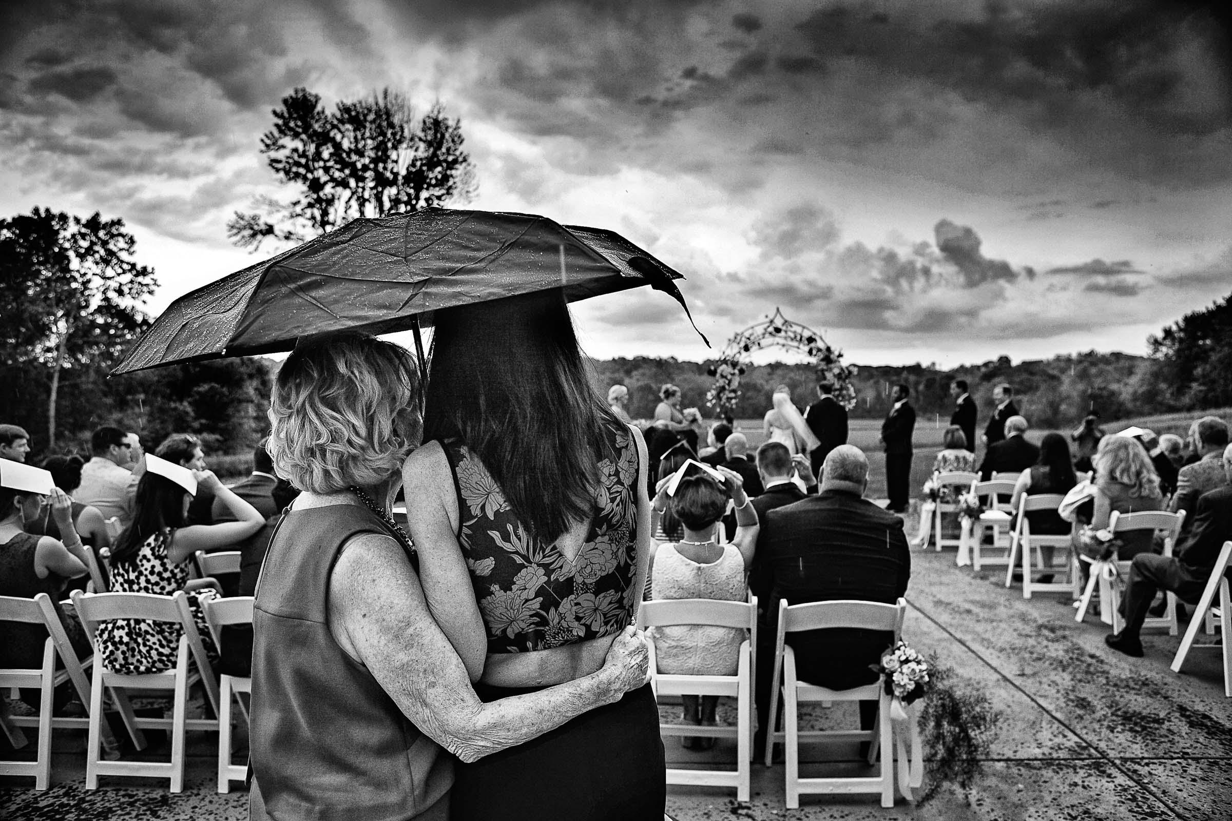 Rain at the ceremony - photo by Marissa Joy Photography