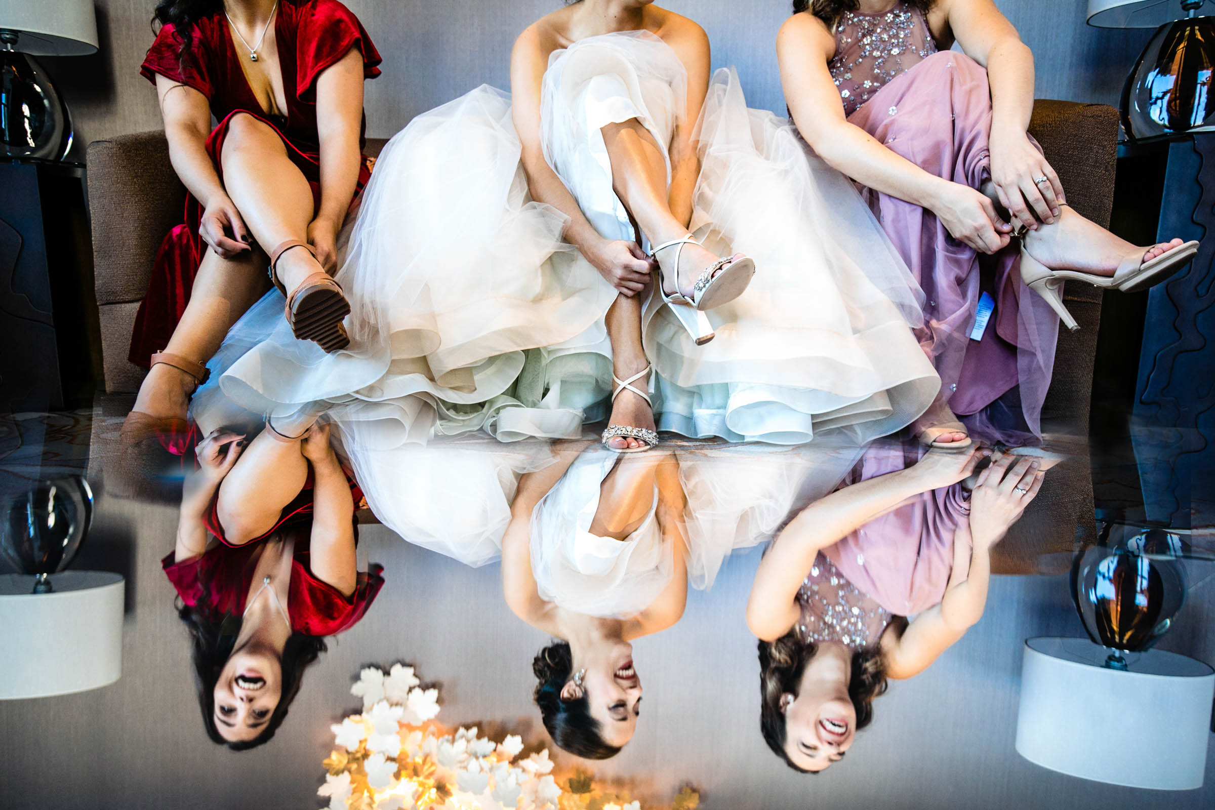Reflected bride and bridal party putting on shoes - photo by Marissa Joy Photography