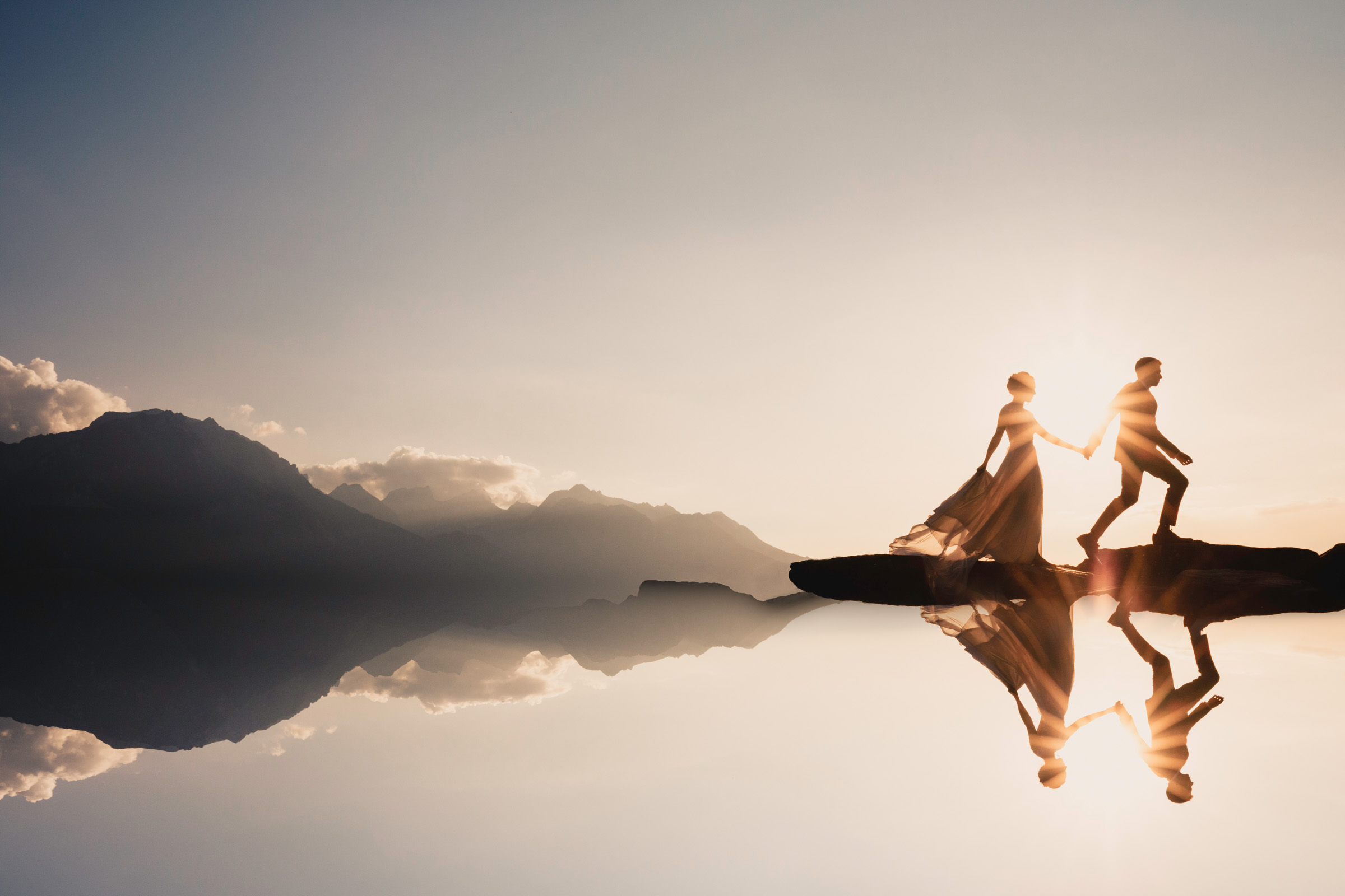 sunstroked couple silhouette with reflections - photo by Marissa Joy Photography
