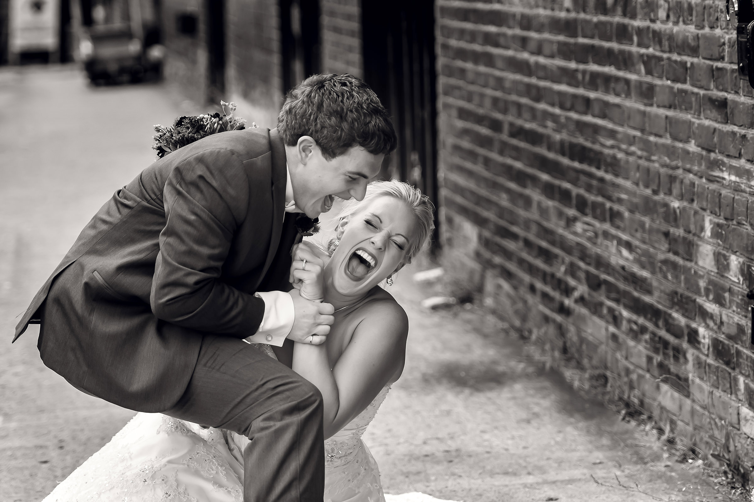 Bride and groom play at wrestling - photo by David & Sherry Photography