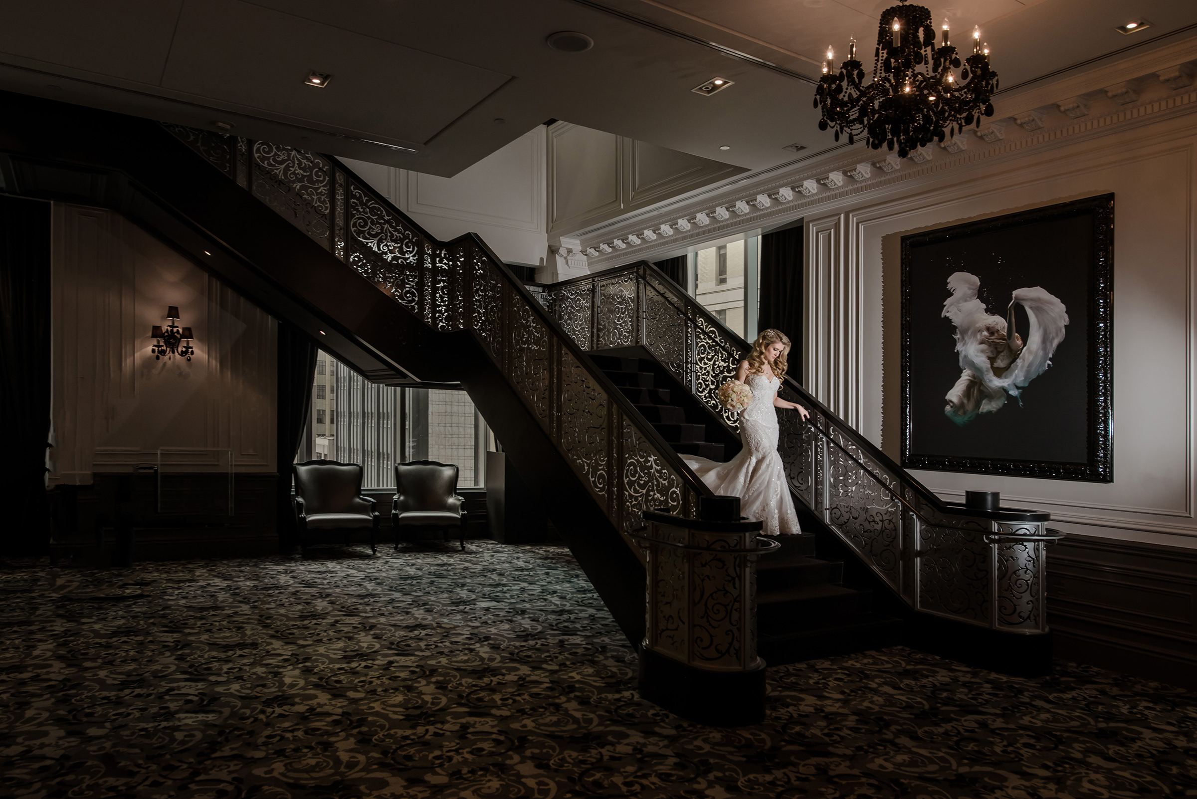 Bride descending ornate staircase - photo by David & Sherry Photography