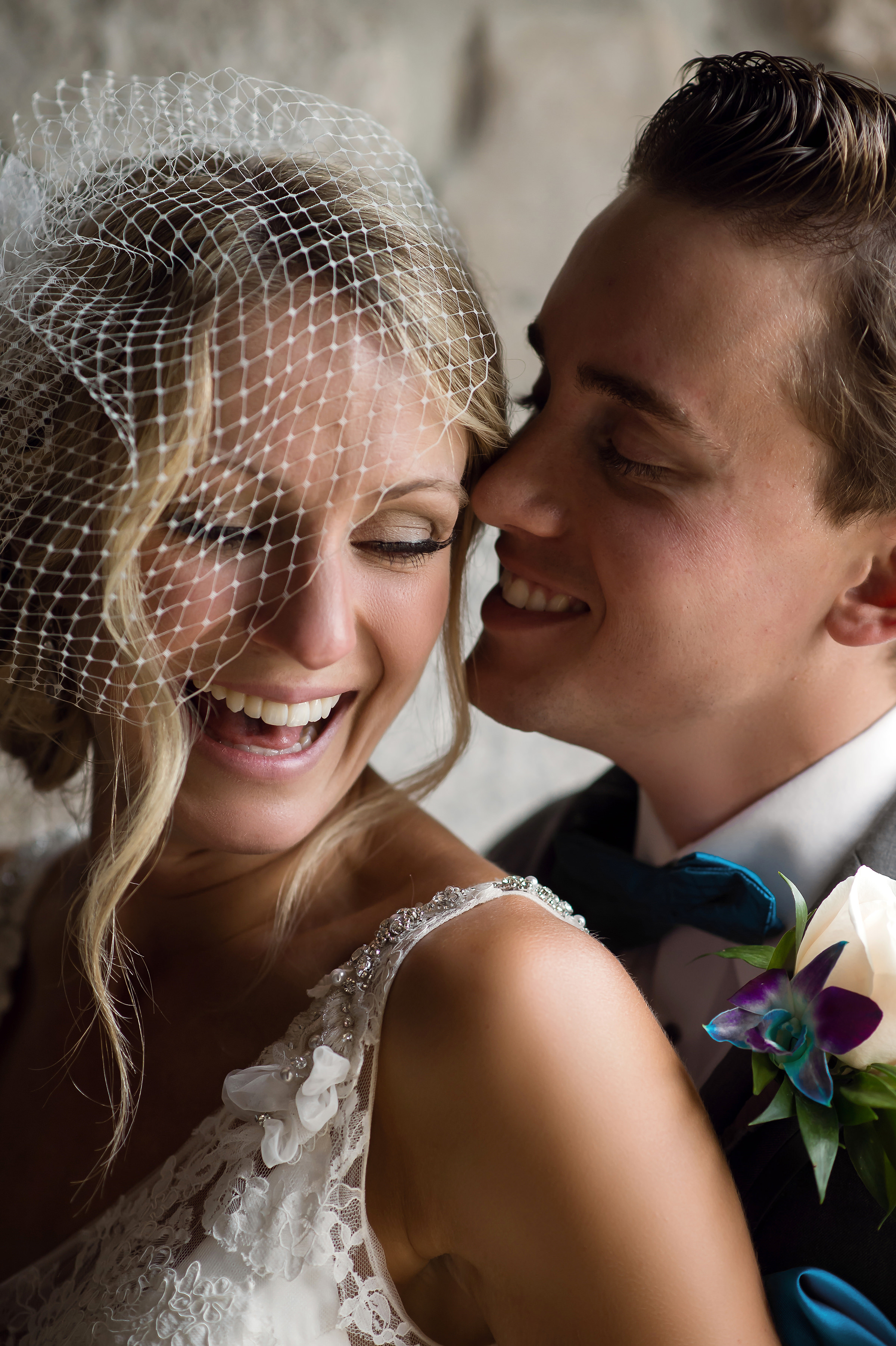 Classic couple of bride in bird-cage veil with groom by David & Sherry Photography