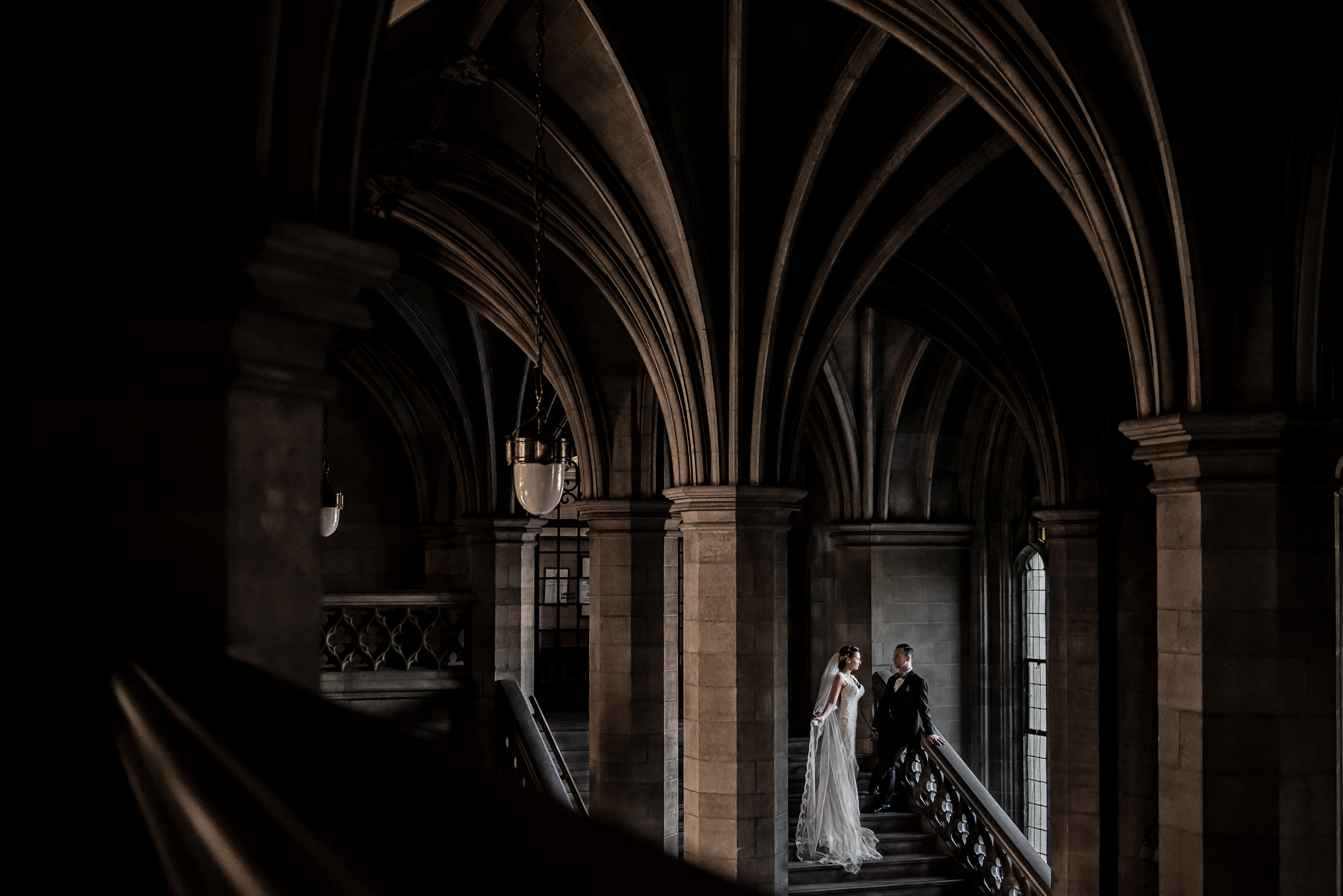 Couple against University of Toronto gothic architecture - photo by David & Sherry Photography