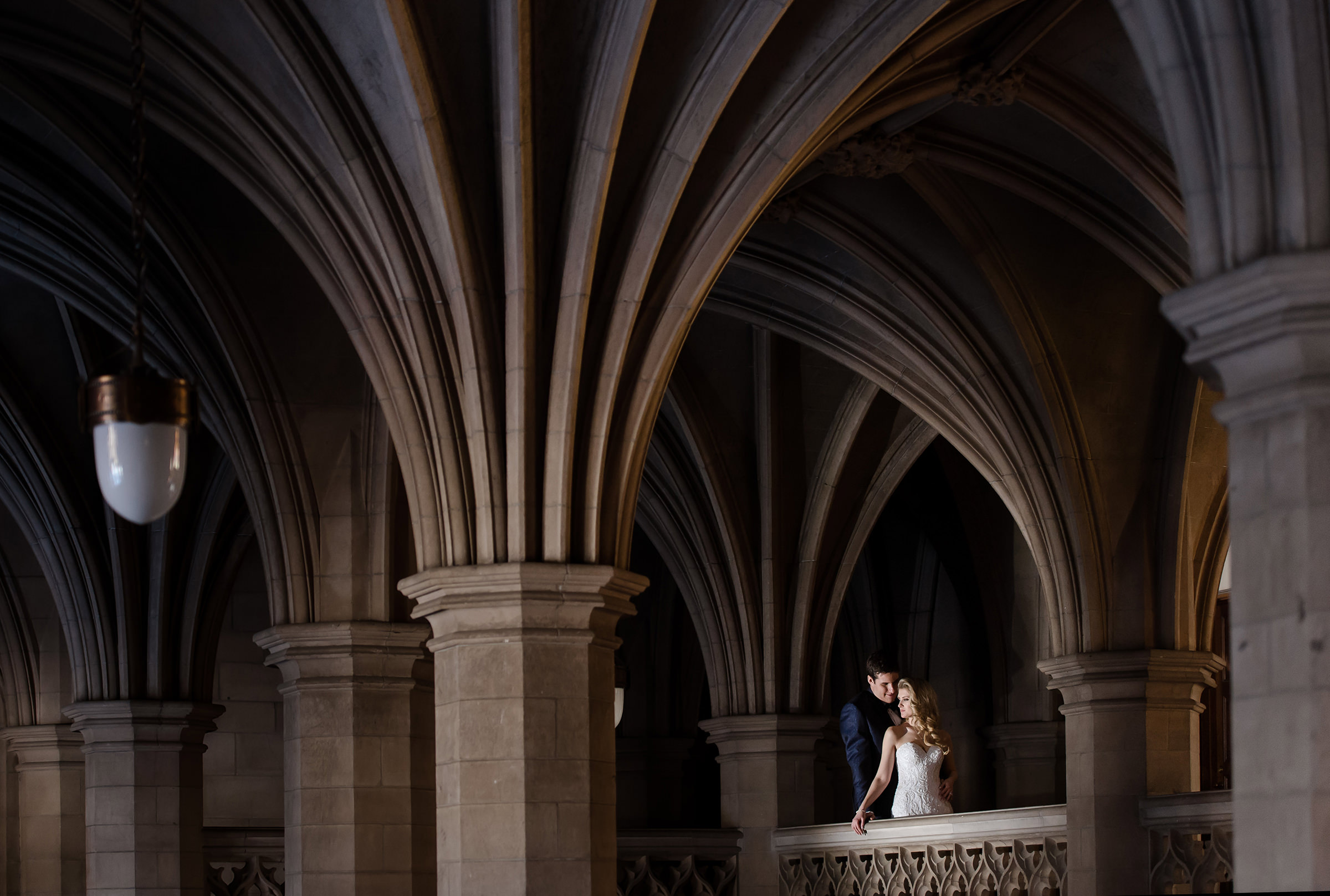 Couple against interior gothic architecture - photo by David & Sherry Photography