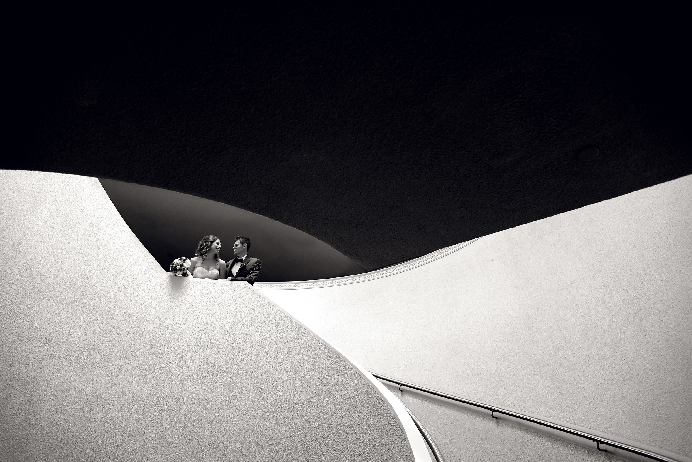 Couple against sleek modern architecture - photo by David & Sherry Photography