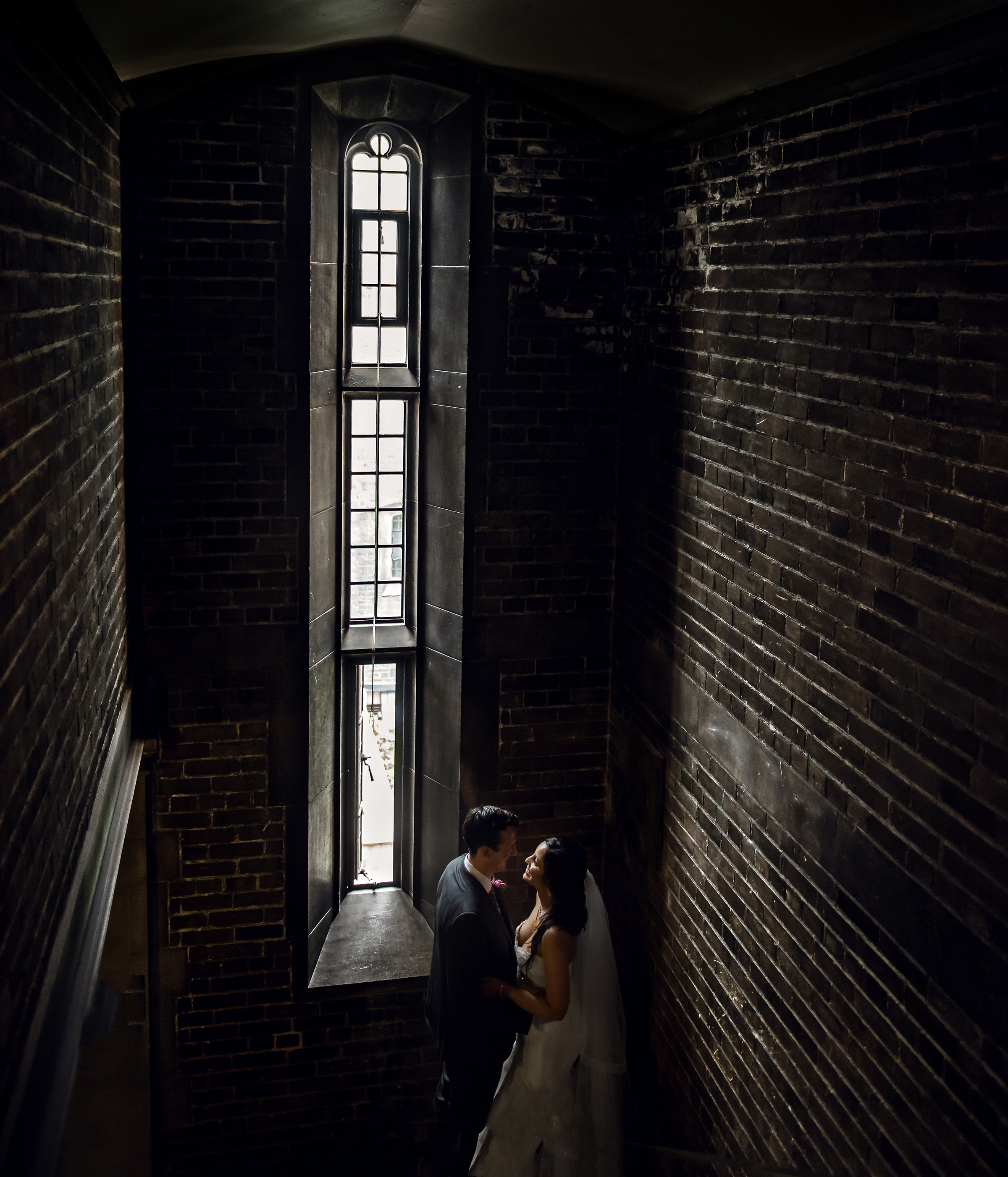 Couple in bricked interior - photo by David & Sherry Photography