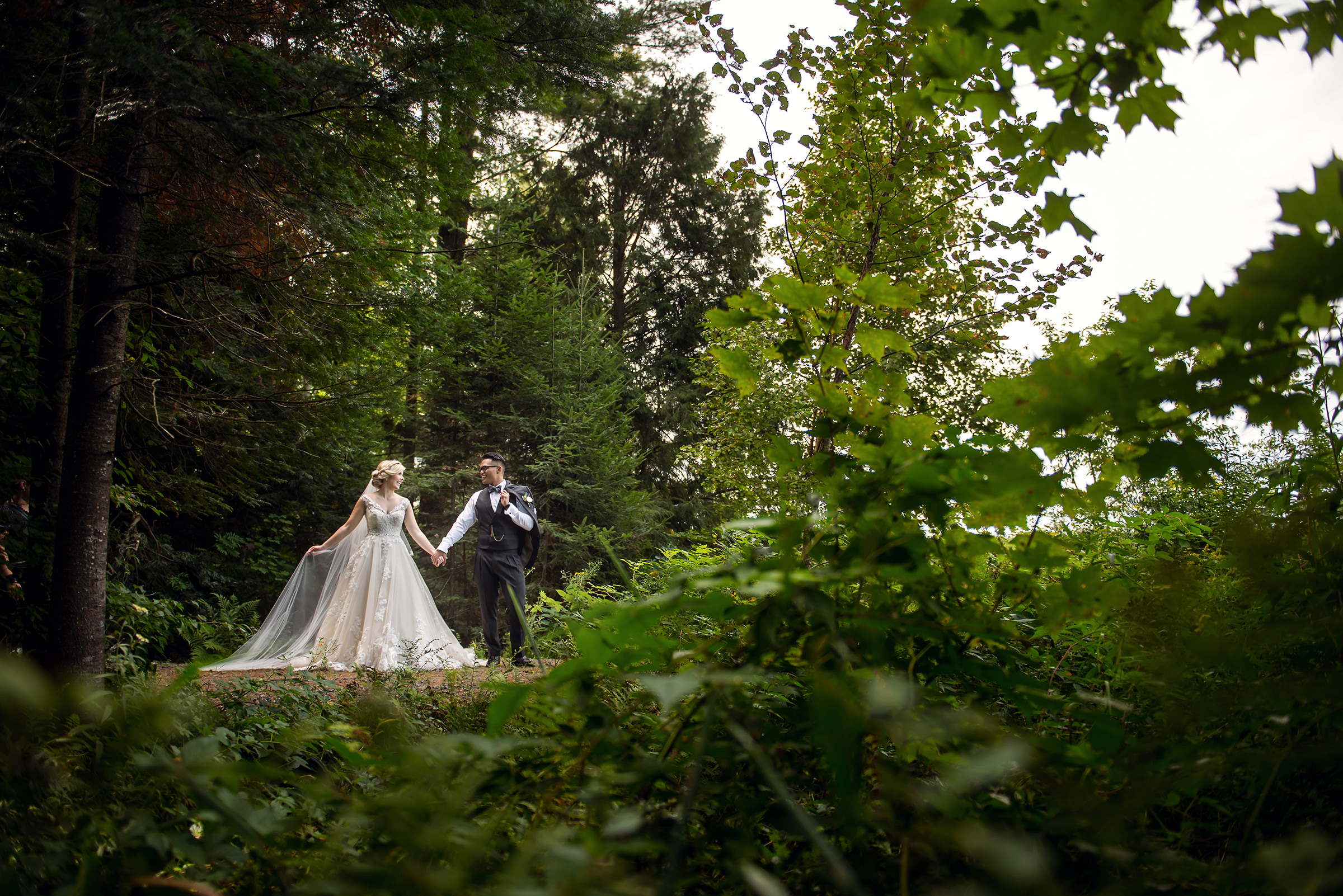 Fairytale bride with groom in forest setting - photo by David & Sherry Photography