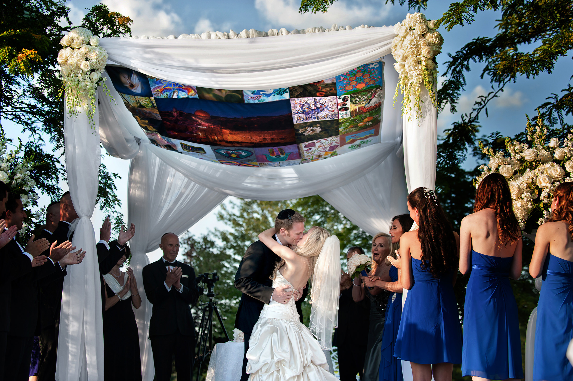 Kissing the bride under chuppah - photo by David & Sherry Photography