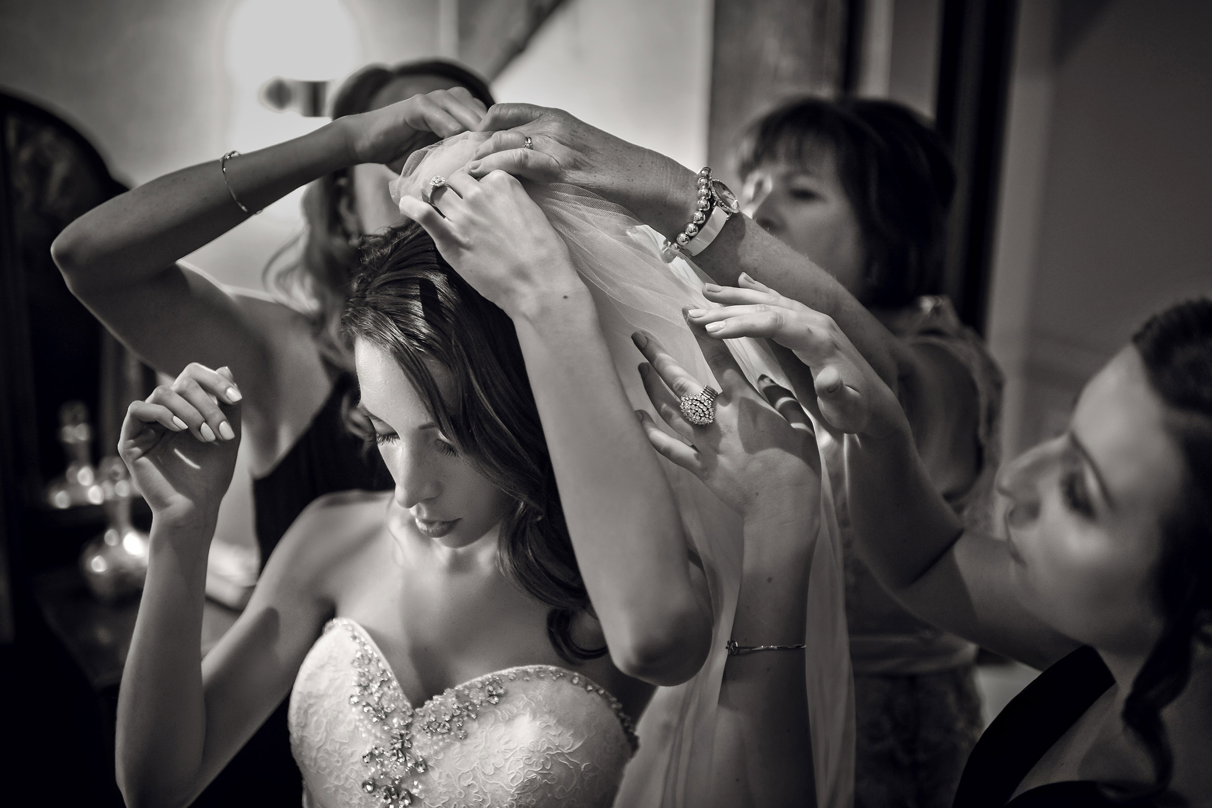 Putting the veil on the bride - photo by David & Sherry Photography
