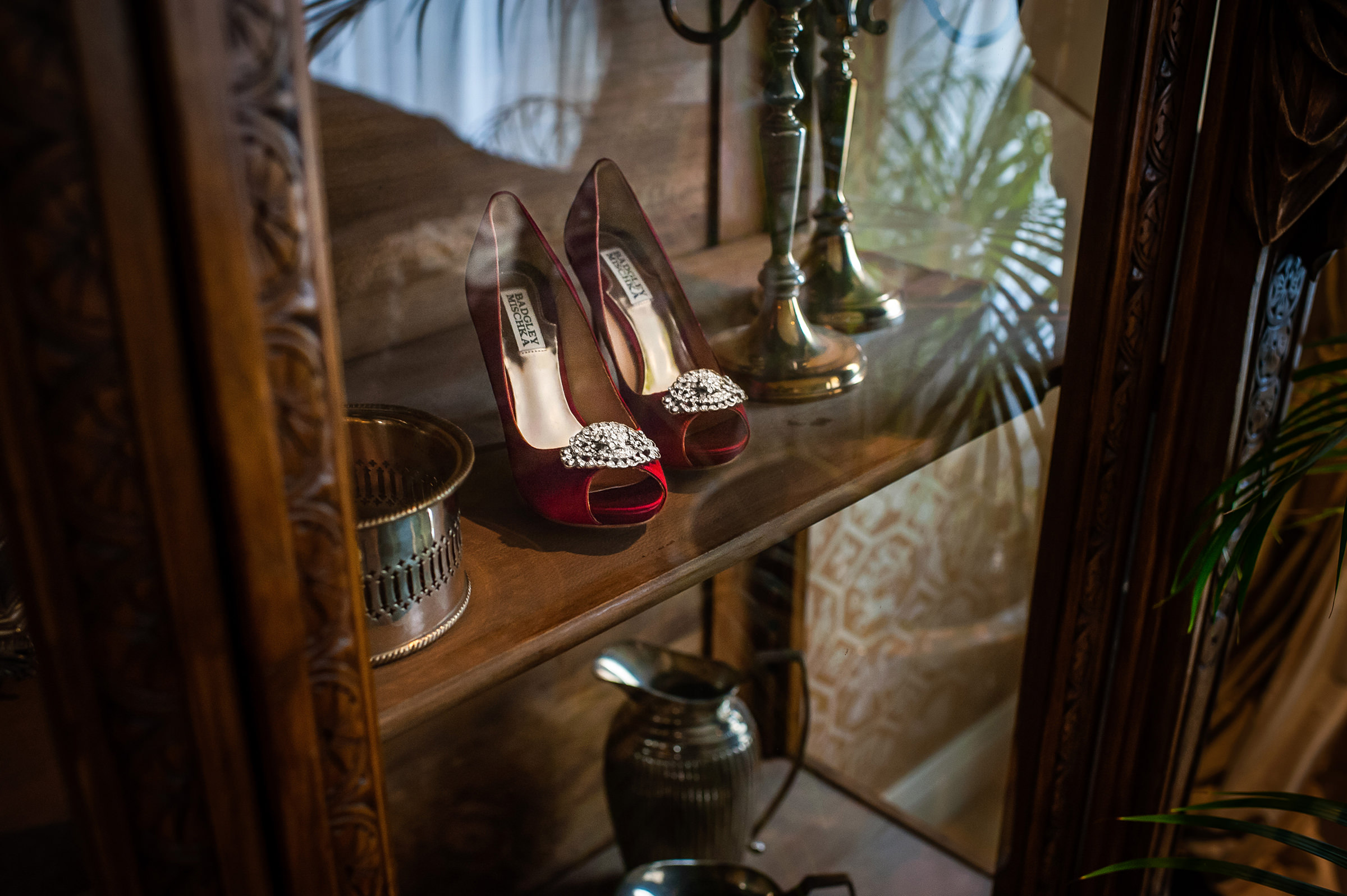 Still life with red Badgley Mischka shoes - photo by David & Sherry Photography