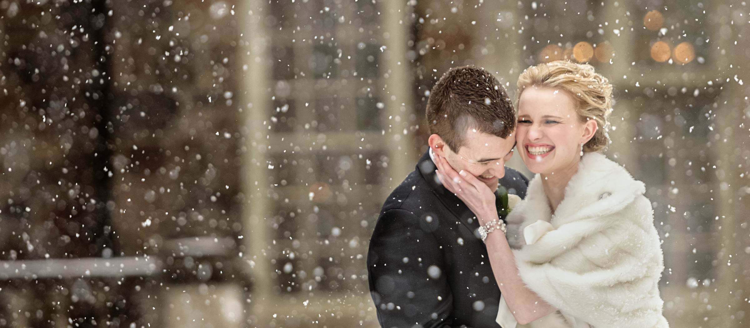Sweet couple portrait in falling snow - photo by David & Sherry Photography