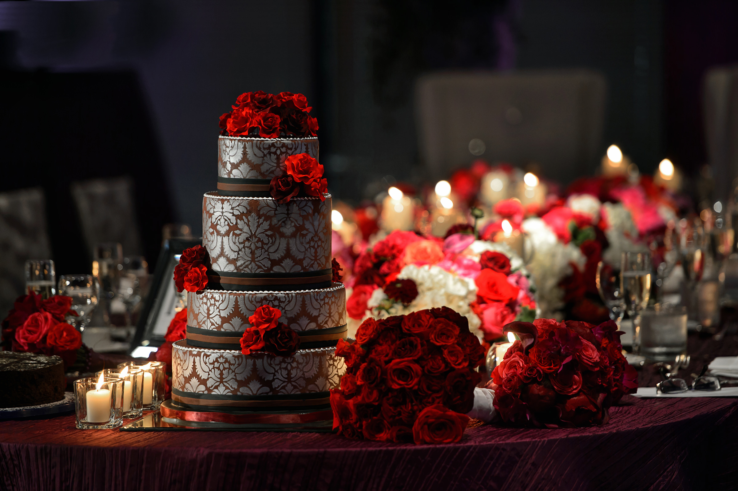 Wedding cake decorated with red roses - photo by David & Sherry Photography