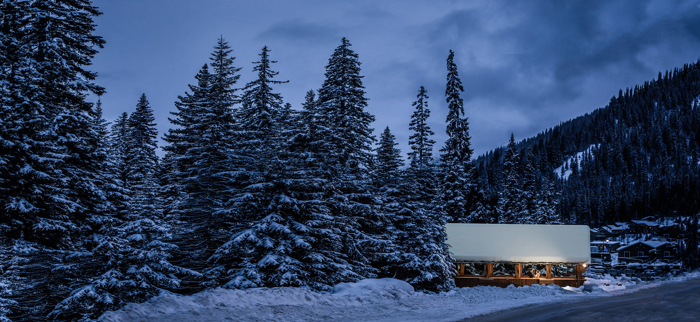 Sun Peaks Grand outside covered bridge in the snow - photo by David & Sherry Photography