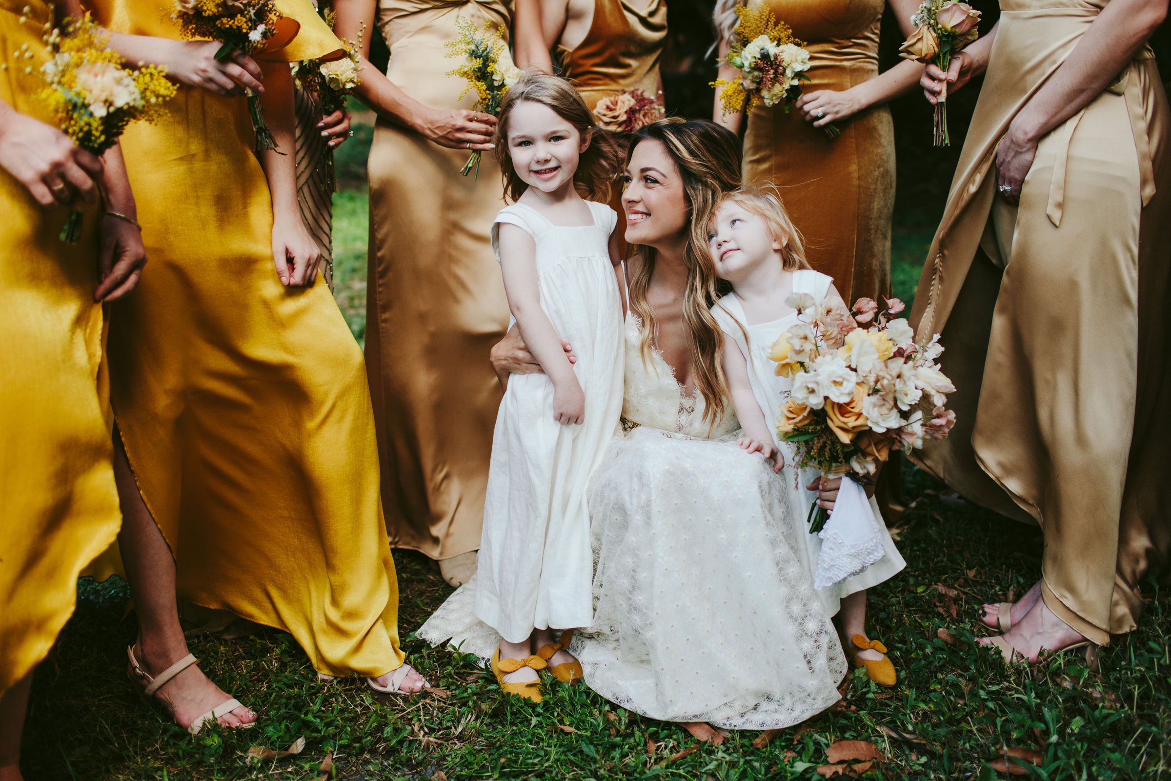Bride and bridesmaids with little flower girls - photo by Melia Lucida