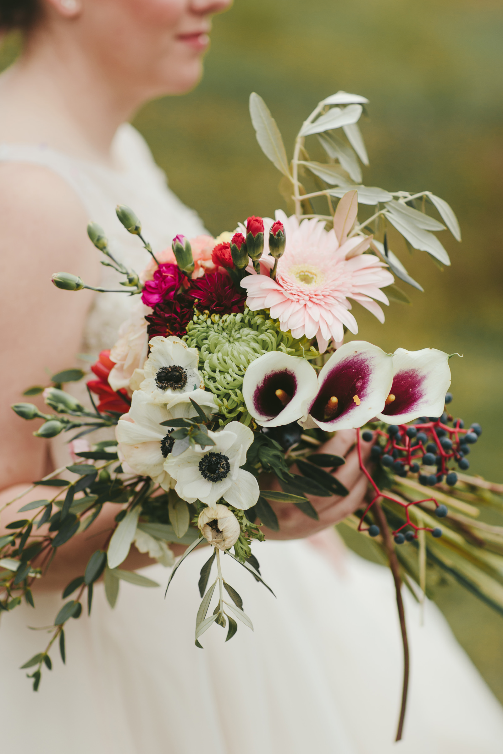 Bride with bouquet - photo by Melia Lucida