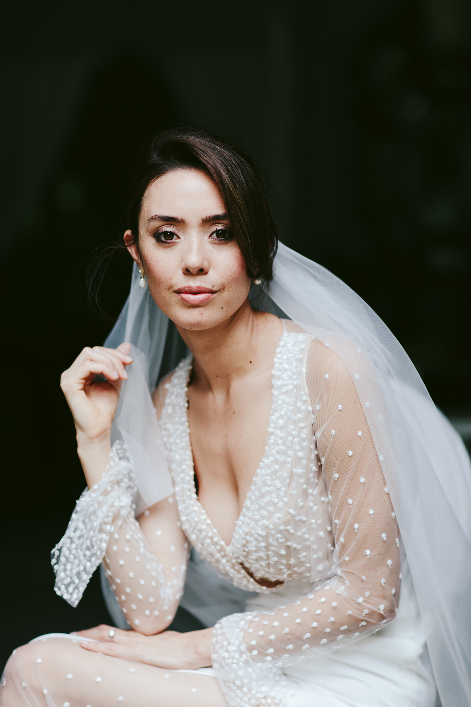 Bride with veil and beaded wedding gown - photo by Melia Lucida