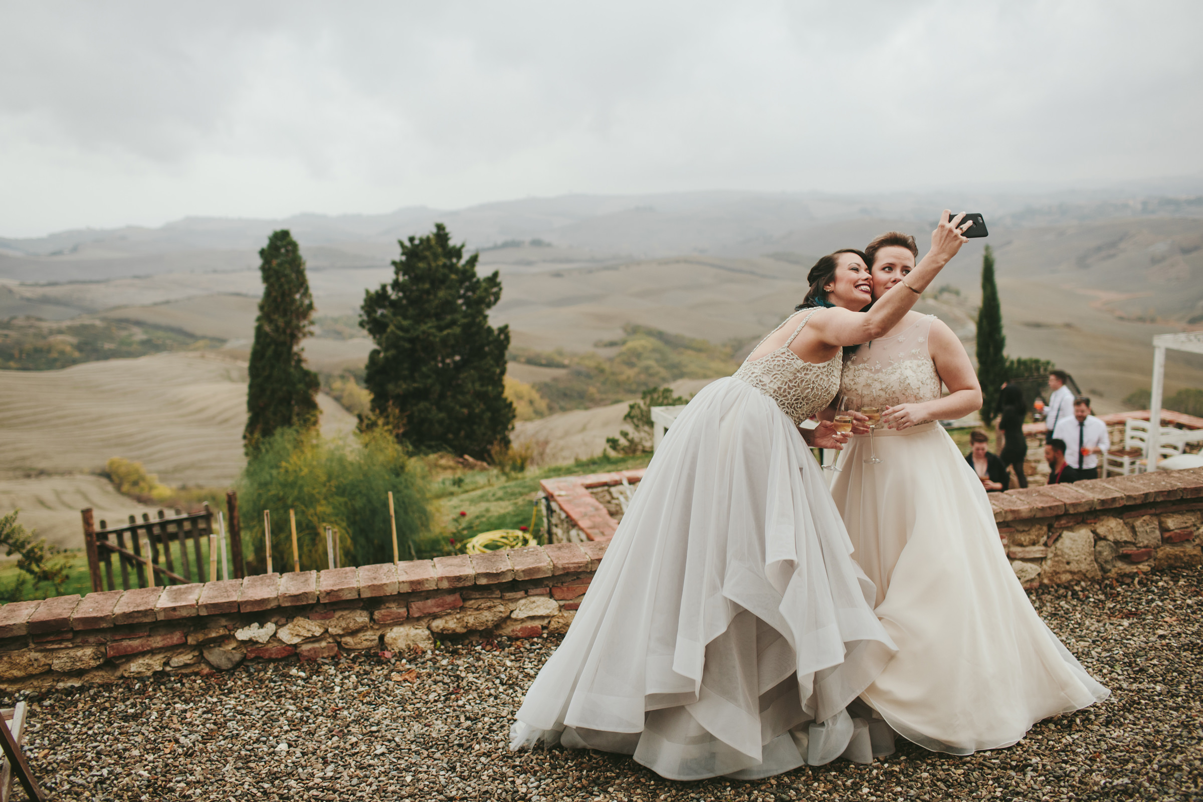 Brides taking selfie - photo by Melia Lucida