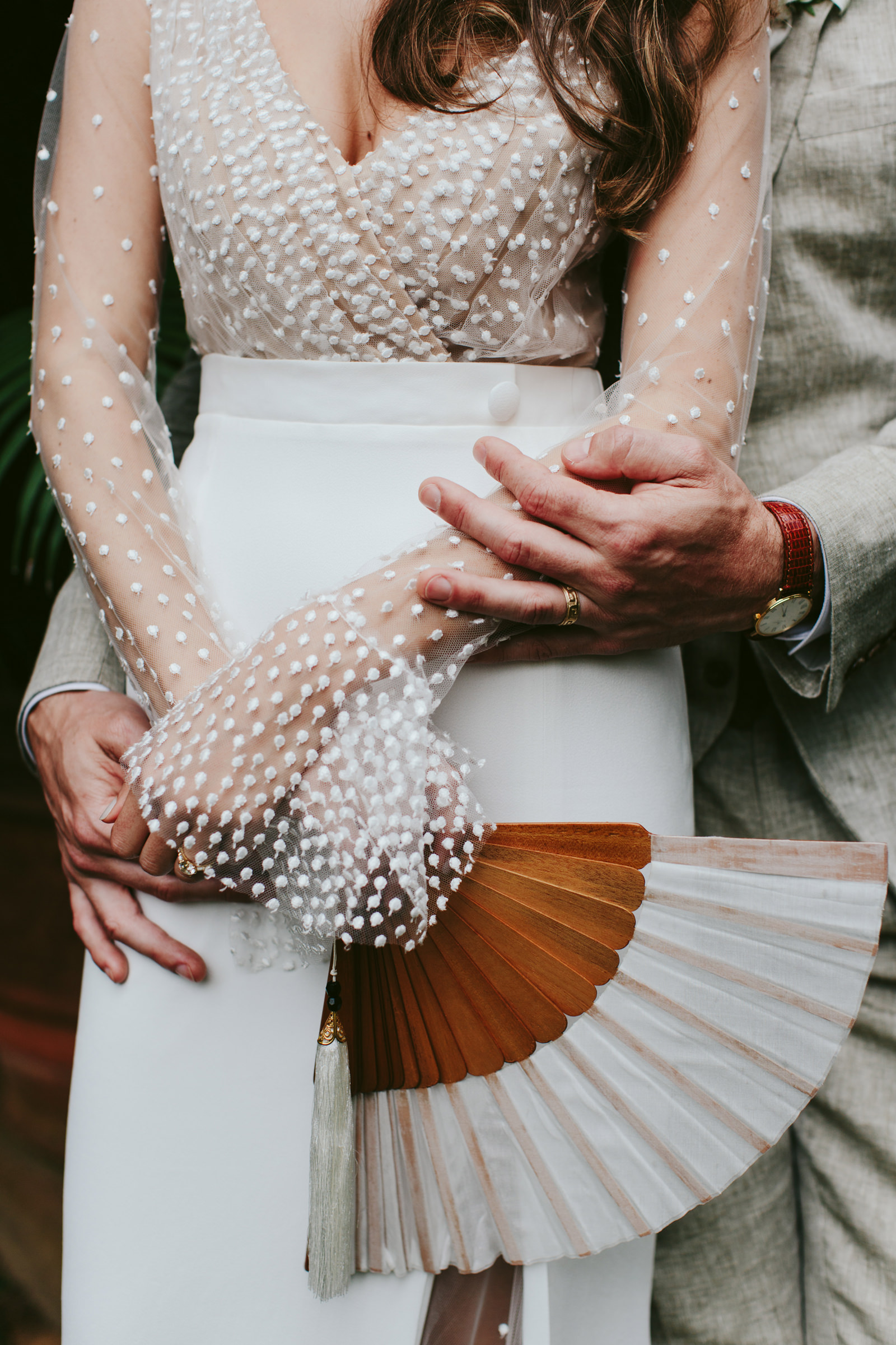 Close up of bride and groom hands - photo by Melia Lucida